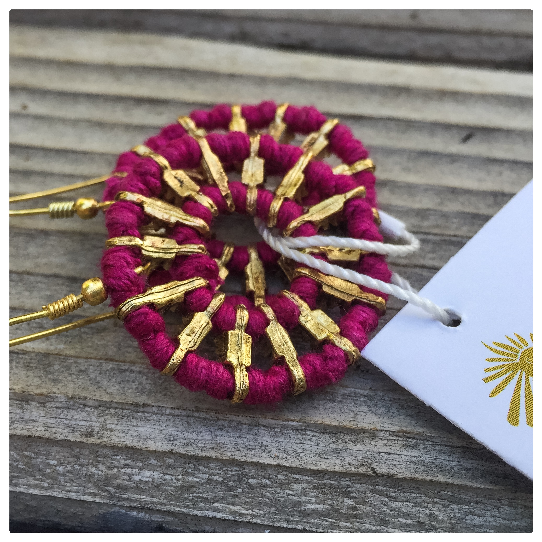 Last but not least,  Noonday Collection ! Made with love in India, these magenta compass earrings are as beautiful as they are purposeful. We can't enough of Noonday and their mission of using fashion to create meaningful employment opportunities for people all over the world.