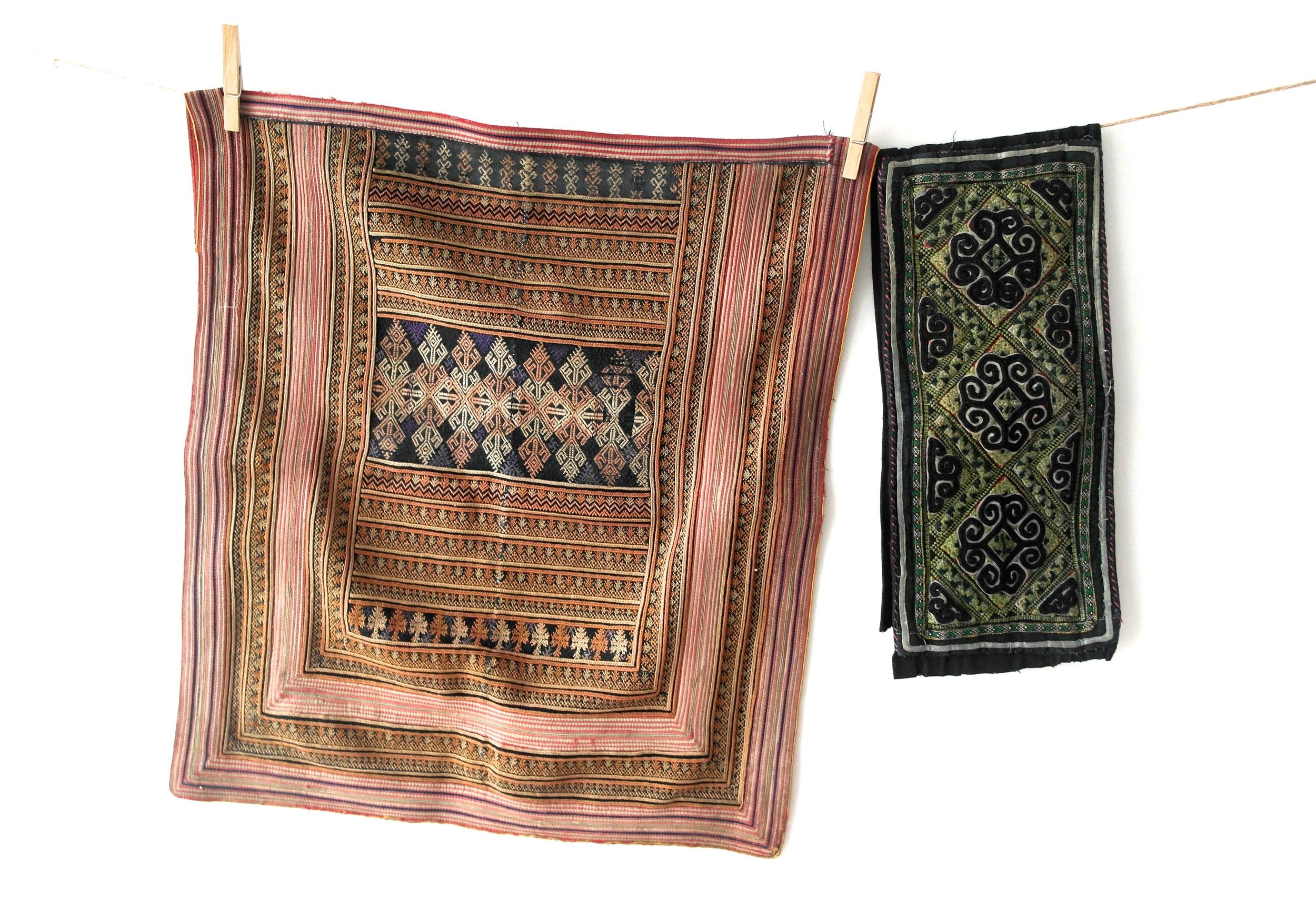 red dzao fabric paneland part of a black hmong belt