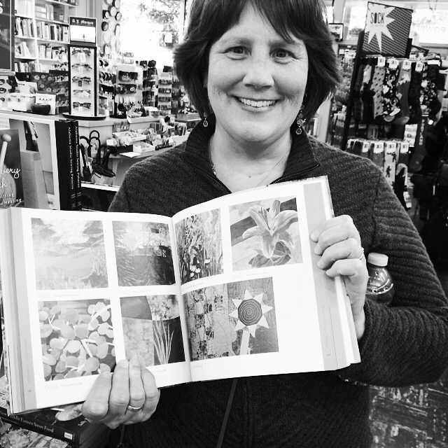 My artwork (bottom right) in the book, 1000 Quilt Inspirations,at Powell's on Hawthorne.