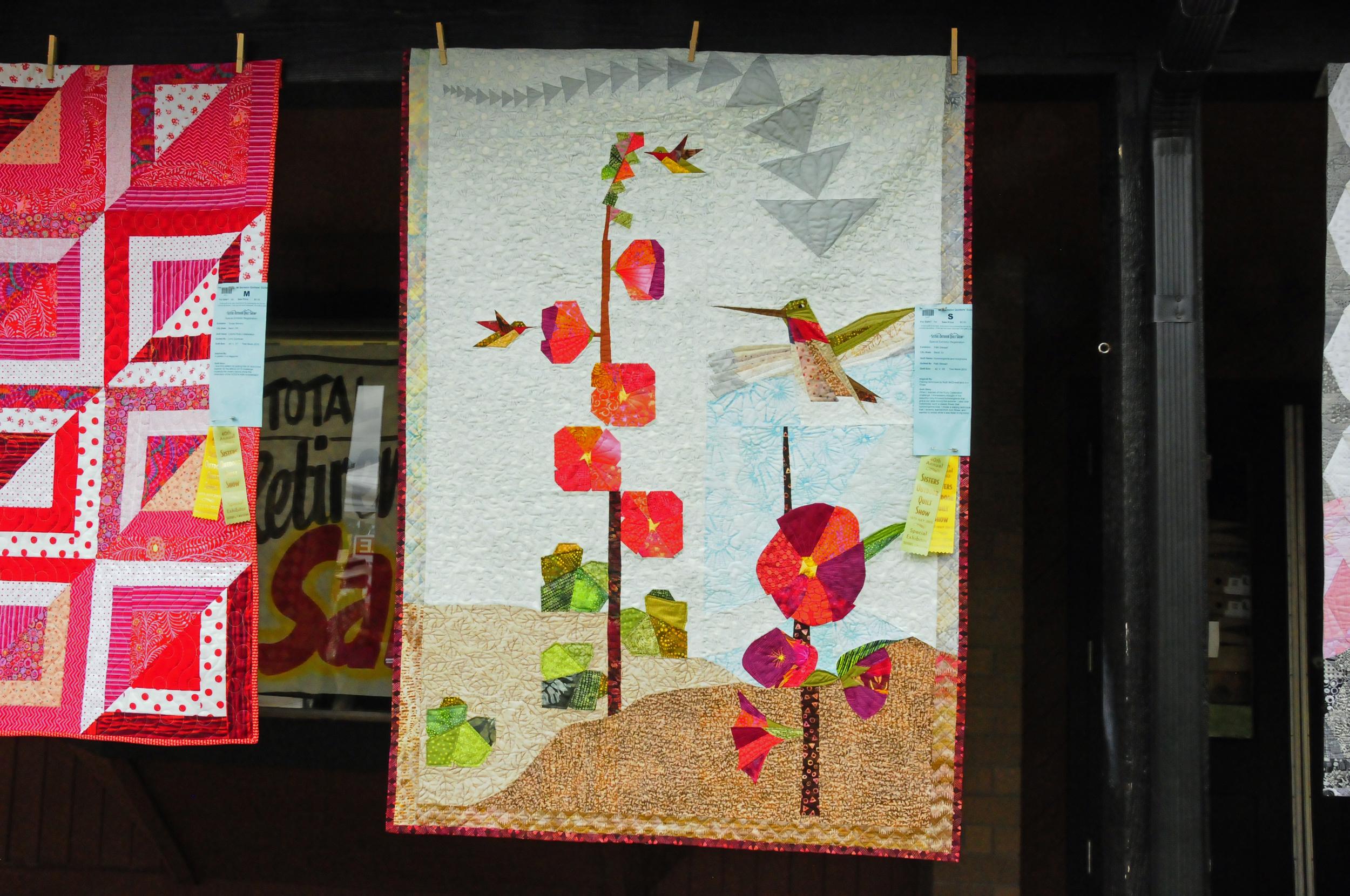 Hummingbirds and Hollyhocks by Patti Stewart