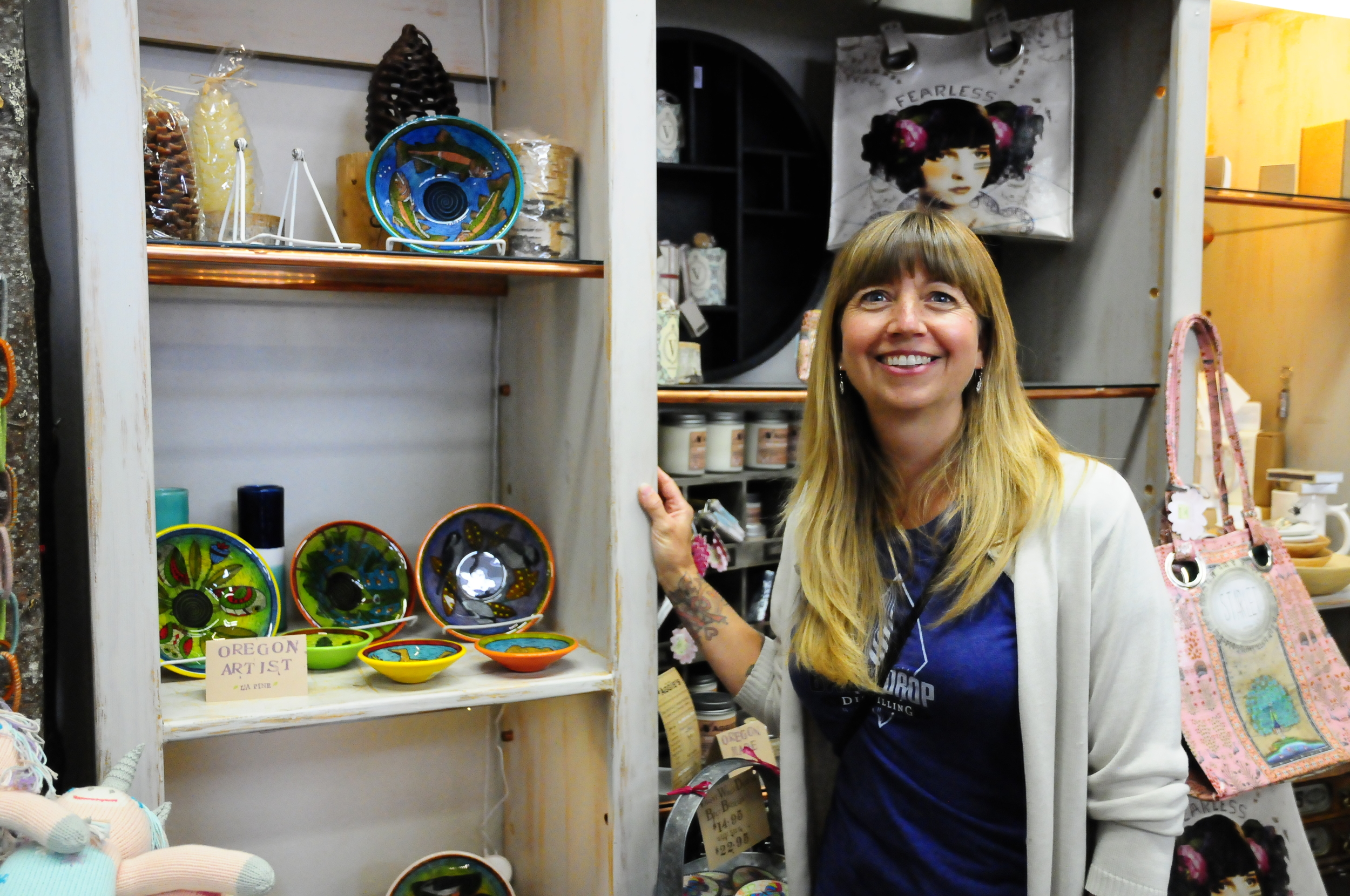 Cheryl and some of her art glass bowls for sale in Twigs.