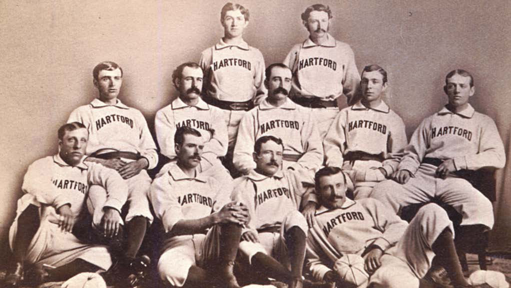 1876 Hartford Dark Blues  L to R: Back Row: Tommy Bond and Candy Cummings. Middle Row: John Burdock, Ed Mills, Bob Ferguson, Bill Harbridge and Tom York. Front Row: Dick Hingham, Doug Allison, Tom Carey, and Jack Remsen.