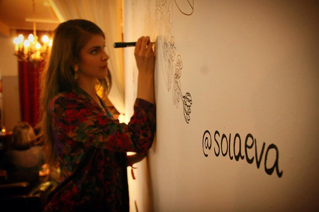 Sólveig Eva drawing a mural during the Fringe Opening Party. Photo by Sveinlaug Sigurðardóttir.