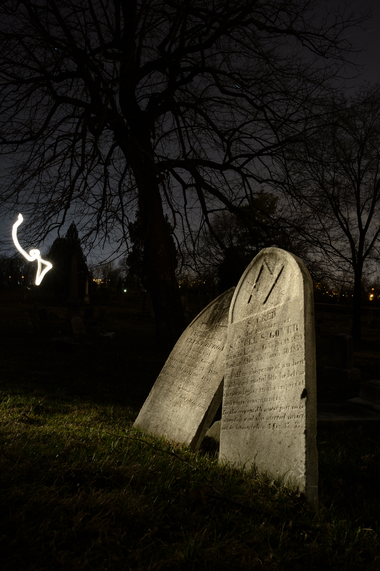 "In this image, while light painting the gravestones, my flashlight slipped out from behind my body and the camera was able to ""see"" it."