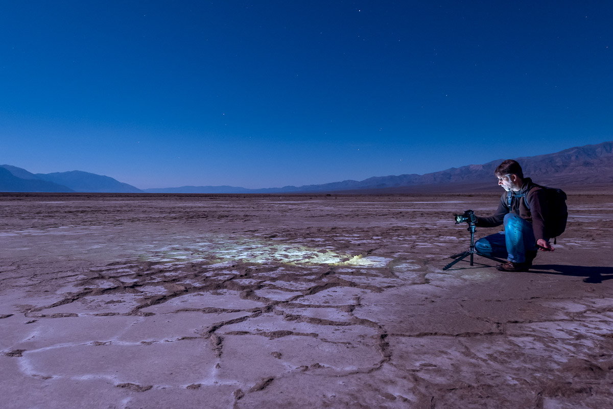 Using my Coast Portland focusing light on the Death Valley salt pans a couple of nights before the workshop began. Also note my Manfrotto Series 1 Traveler tripod, my Nikon D750 and Peak Design Everyday Backpack. Four sponsors in one photo, totally unplanned! See, we really do use this stuff! Photo by Chris Nicholson.