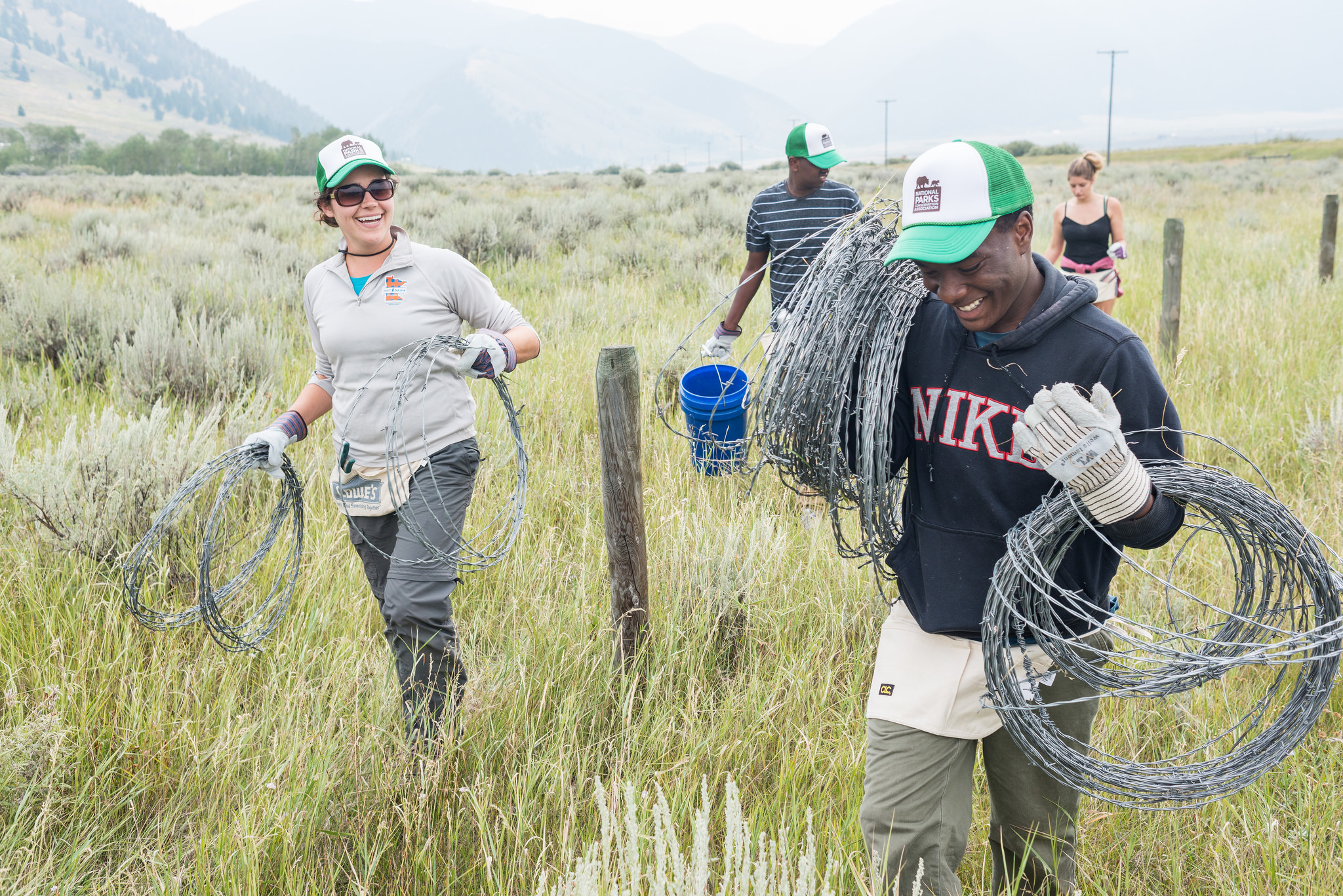 NPCA volunteers work to remove fencing near the western entrance of Yellowstone National Park to allow pronghorn antelope to reestablish historic migration routes. Photo courtesy of the National Park Conservation Association.