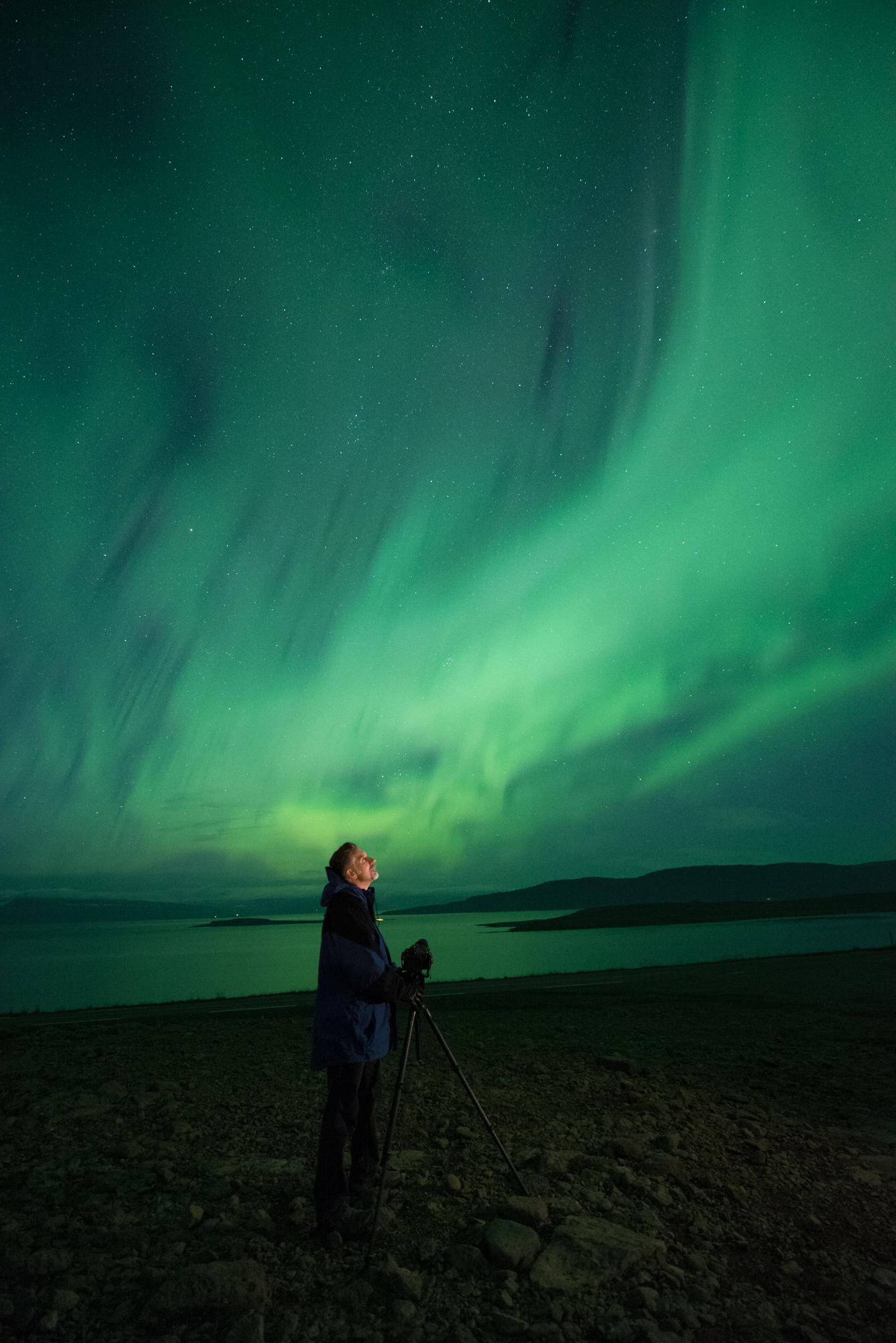 Lance under an Icelandic aurora. 4 seconds, f/2.8, ISO 6400. Nikon D750 with a 14mm lens. © Gabriel Biderman.