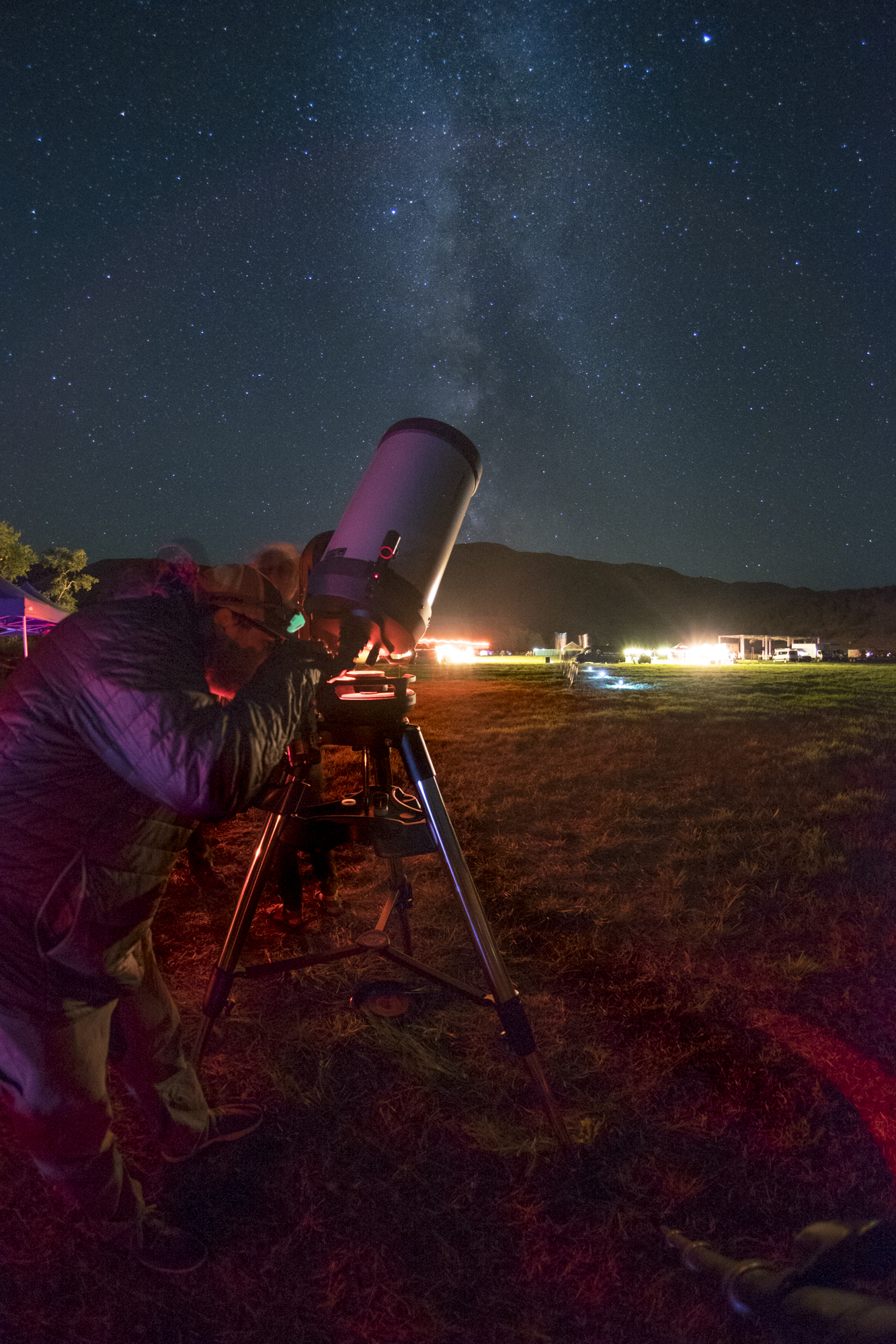 Figure 9. Michael Hollander from B&H using a telescope at the eclipse event in Oregon. Photographed with a  Fuji X-T1  and a  7artisans 7.5mm Fisheye f/2.8  lens at 30 seconds, f/2.8, ISO 6400.