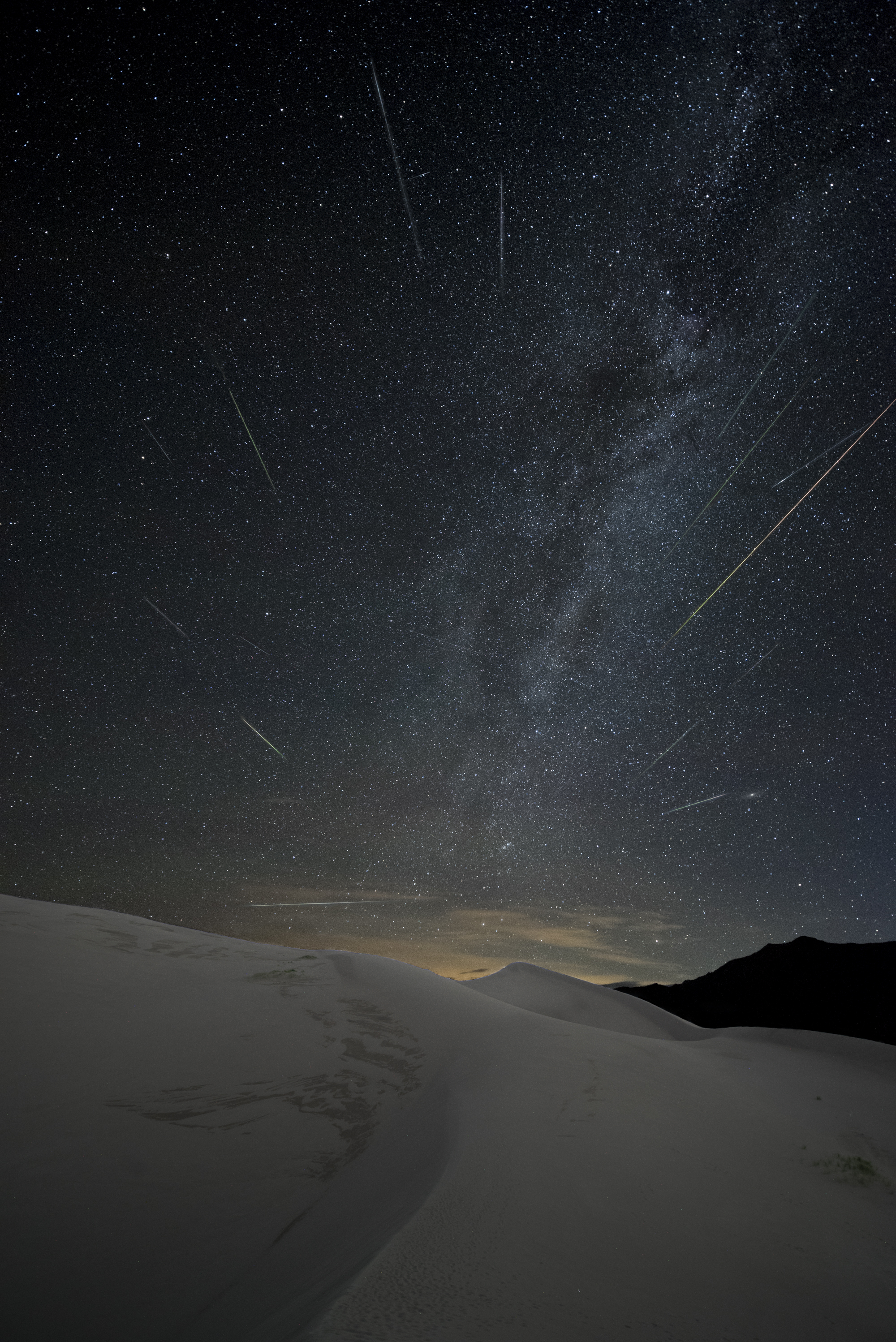 Great Sand Dunes National Park, Colorado.  Nikon D750 ,  15mm Zeiss Distagon f/2.8  lens. 234 images at 22 seconds, f/2.8, ISO 6400, plus a single exposure at 382 seconds, ISO 2000 for the landscape after moonrise. Photo © 2017 Matt Hill.