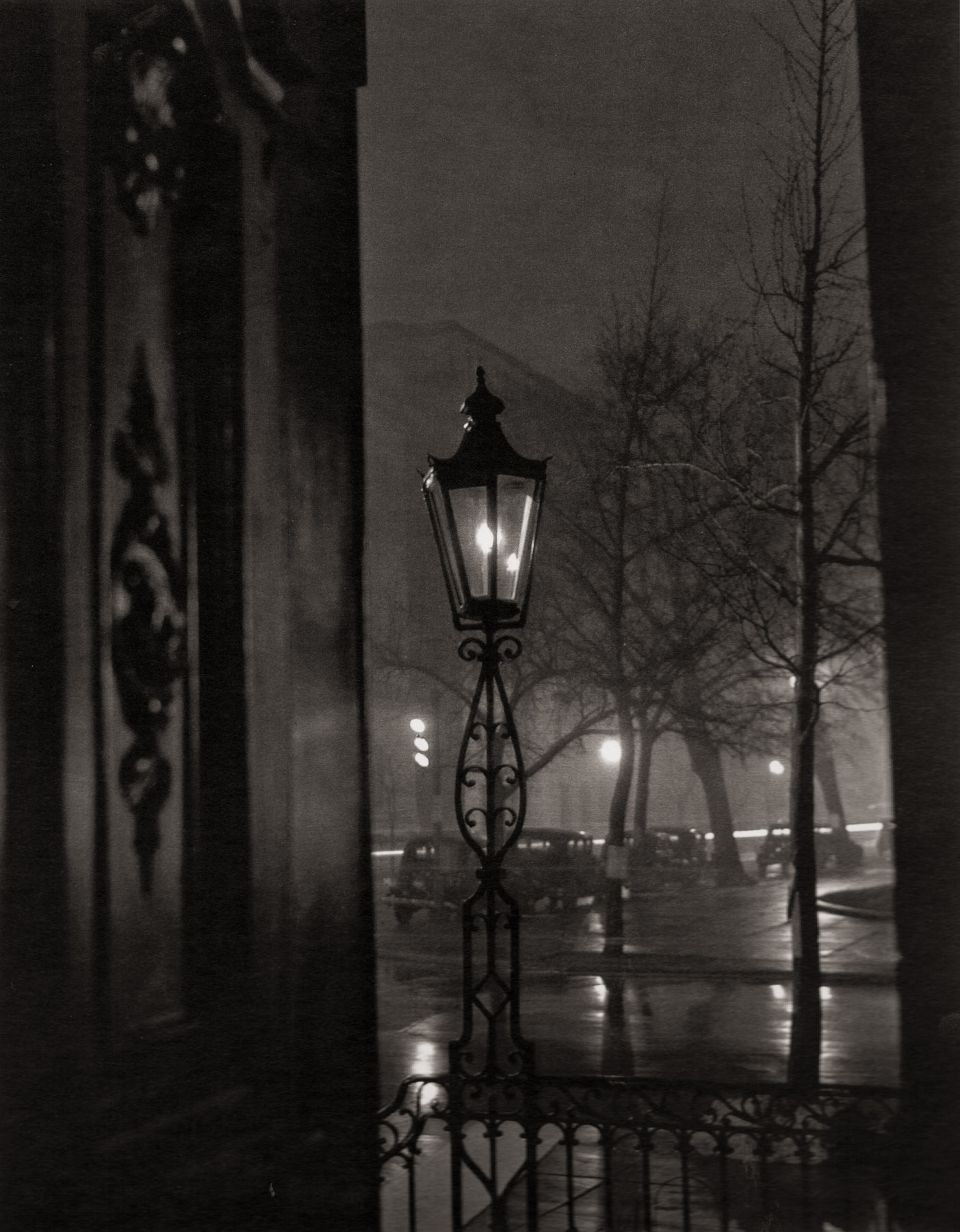 """""""Decatur House."""" A shallow depth of field detail image of Decatur House at the corner of Jackson Place and H Street in Lafayette Square. The square had long been one of the most prestigious addresses in Washington, with the residences of presidents, vice presidents, secretaries of state, and other wealthy and powerful people. Wentzel planted the light bulb behind the frame of the lamp to minimize overexposure, but the light bled out from the sides all the same. You can just make out a row of late-1930s cars in the middle ground."""