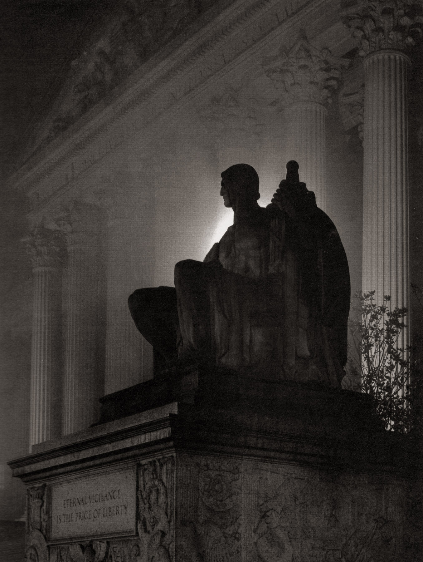 """National Archives II."" A dramatic image of the sculpture ""Guardianship"" by James Earle Fraser, best-known as the designer of the buffalo nickel. Fraser's sculpture graces many of the buildings constructed during the New Deal era. Beneath the sculpture is a quote by Thomas Jefferson: ""Eternal vigilance is the price of liberty."" Careful placement of a light source behind the sculpture adds to the drama."