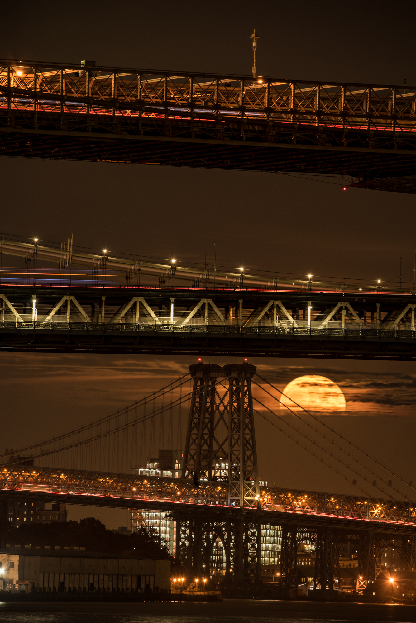 I needed a 3-minute window for the supermoon to shine through the clouds and bridges, a juxtaposition of time and place that required some serious planning with the PhotoPills app. Nikon D750 with a  Tamron 150-600mm f/5-6.3  lens set to 370mm. 1/2, f/11, ISO 400.