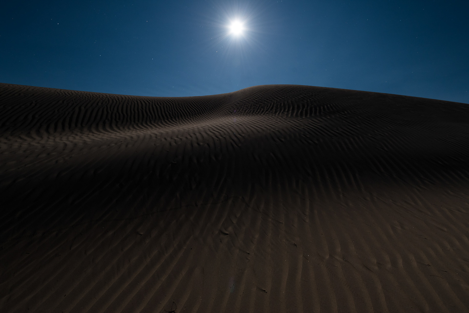 The moon rising over Mesquite Flat Dunes,  Death Valley  National Park.  Nikon D750 ,  Tamron 15-30mm f/2.8 . Dunes light painted with a  Coast HP5R  flashlight. © 2016 Lance Keimig.