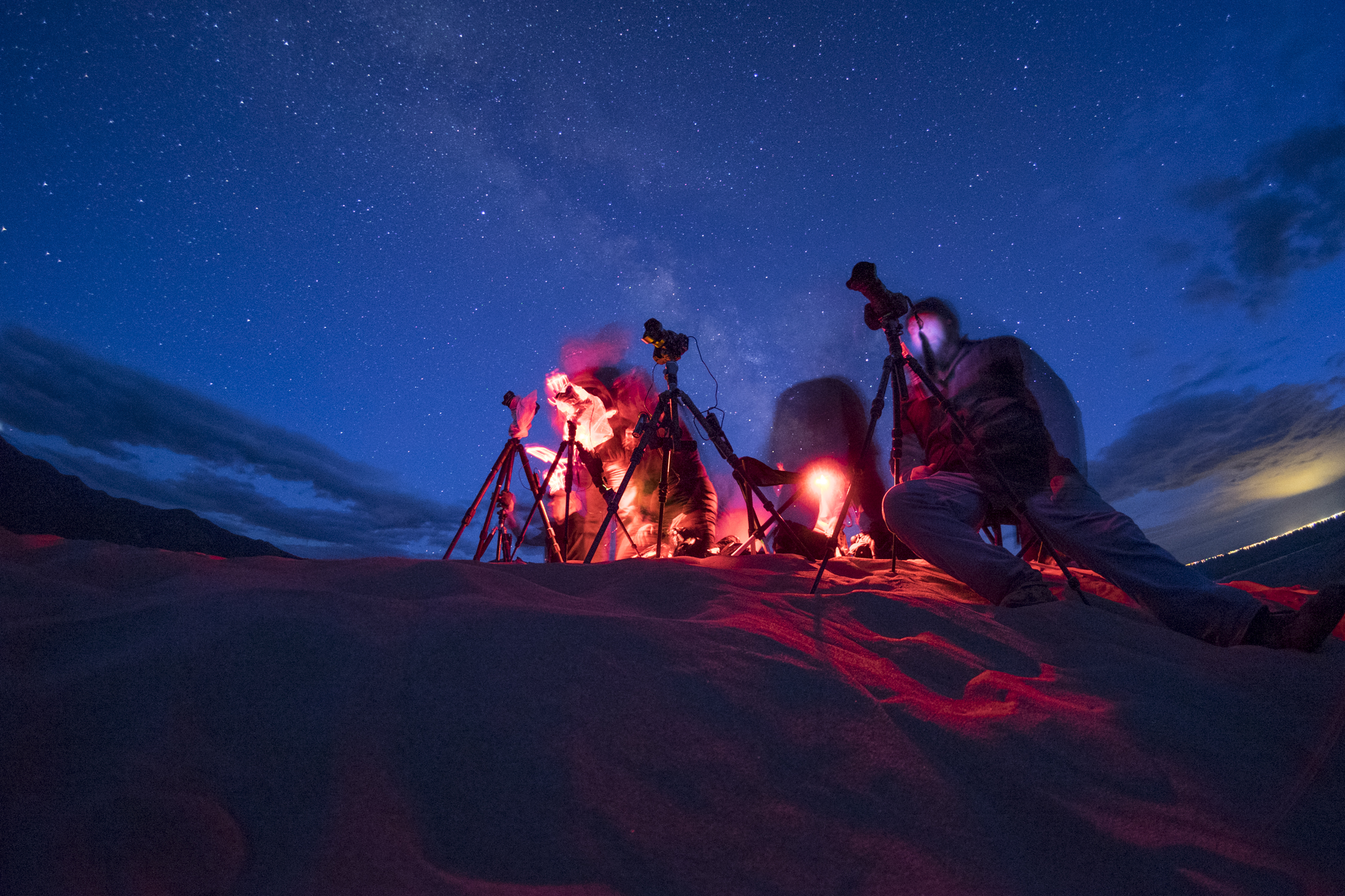 """Notice how the red light """"bleeds"""" into the area surrounding these photographers at Great Sand Dunes National Park. Photo by Matt Hill."""