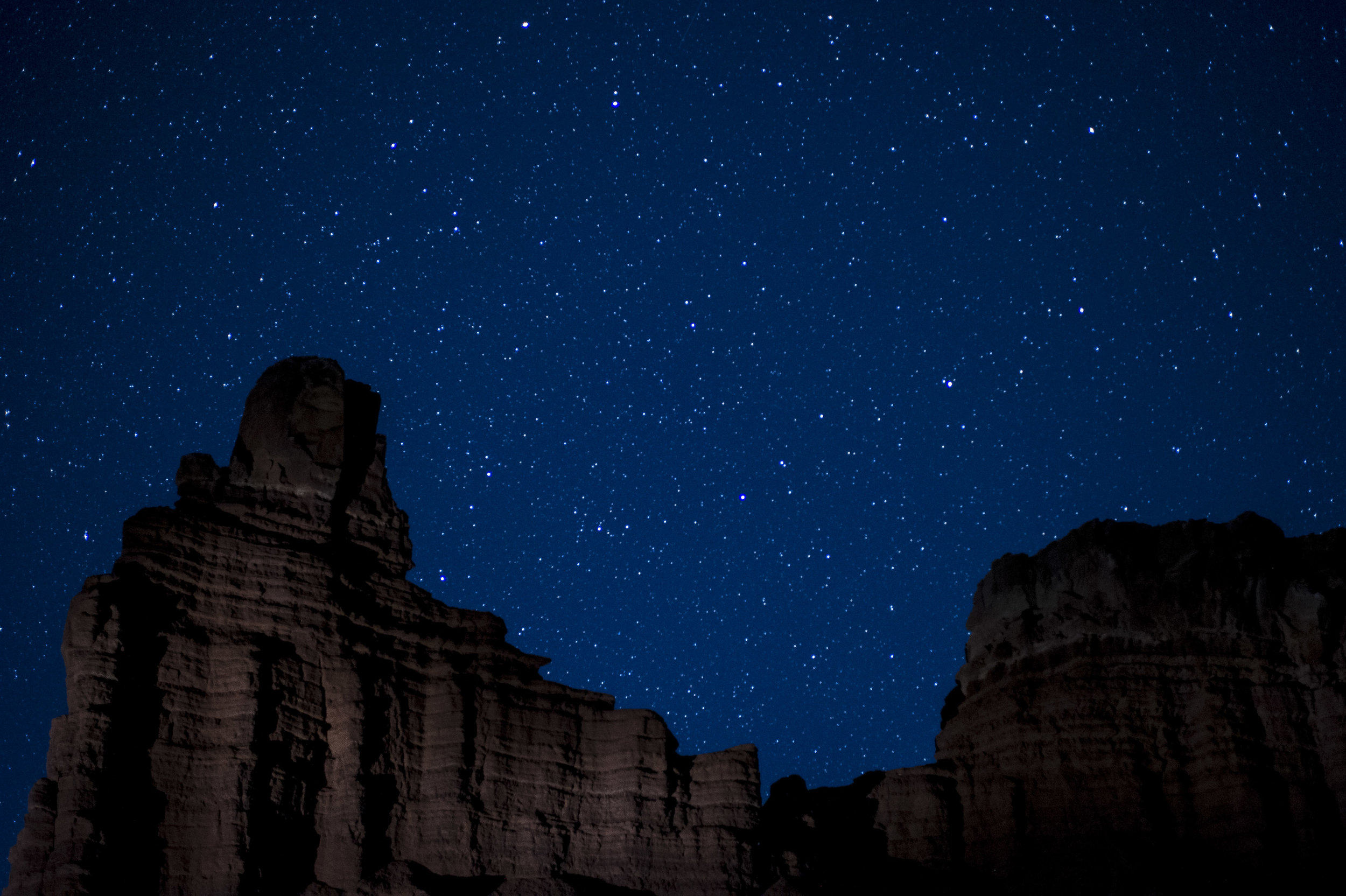 While shooting with Gabe and Matt in  Capitol Reef National Park , we all autofocused on infinity at sunset and taped down our focus rings before photographing Chimney Rock under the stars. Nikon D3s with a  Nikon 28-70mm f/2.8  lens. 15 seconds, f/2.8, ISO 4000.