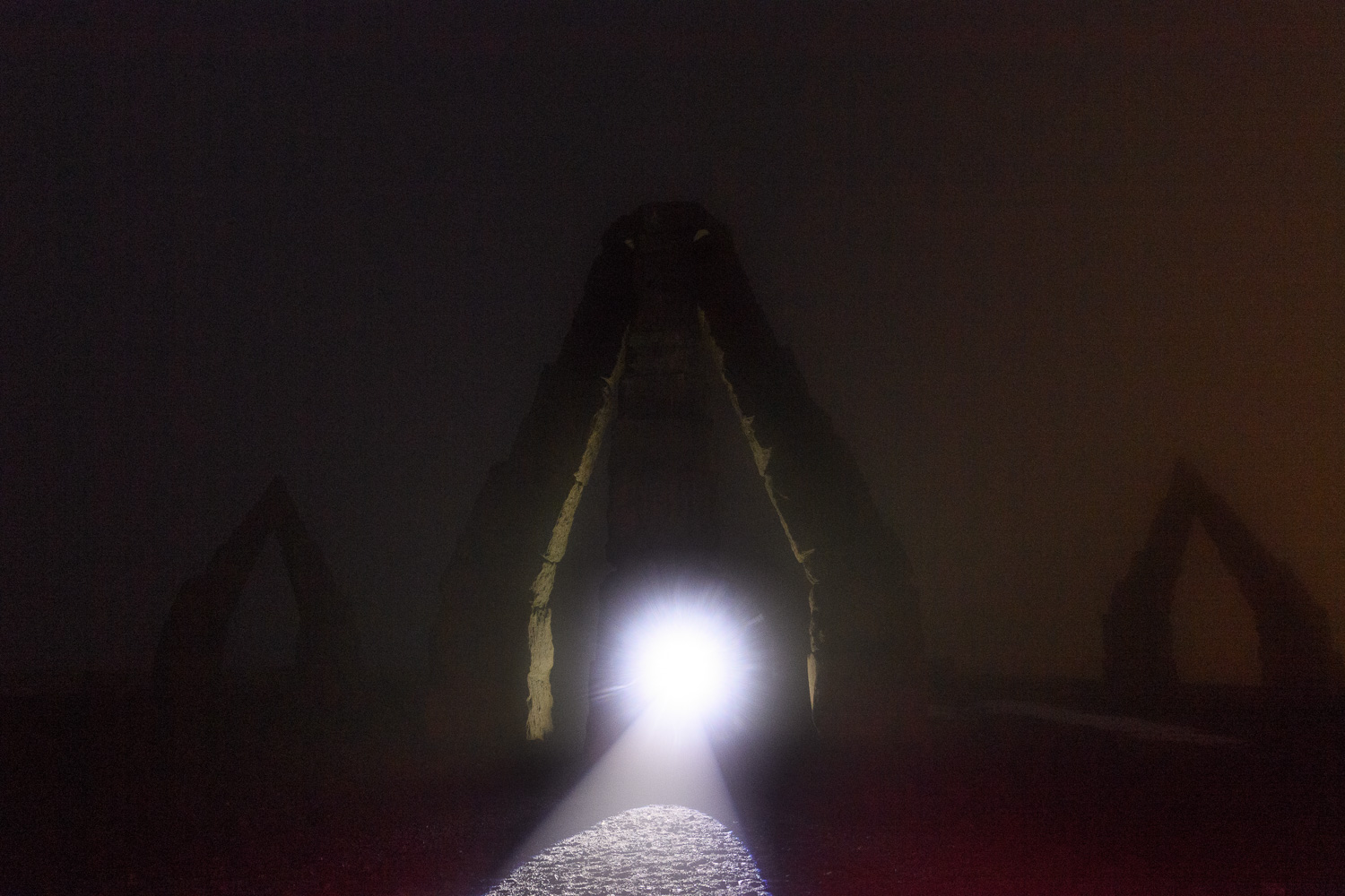 At Arctic Henge in Iceland, the fog made it tricky to illuminate our subject from a distance, so I put a  Coast HP5R  flashlight on the rock and autofocused on the lit bulb. Nikon D5 with a Nikon 14-24mm f/2.8 lens. 30 seconds, f/4.5, ISO 3200.