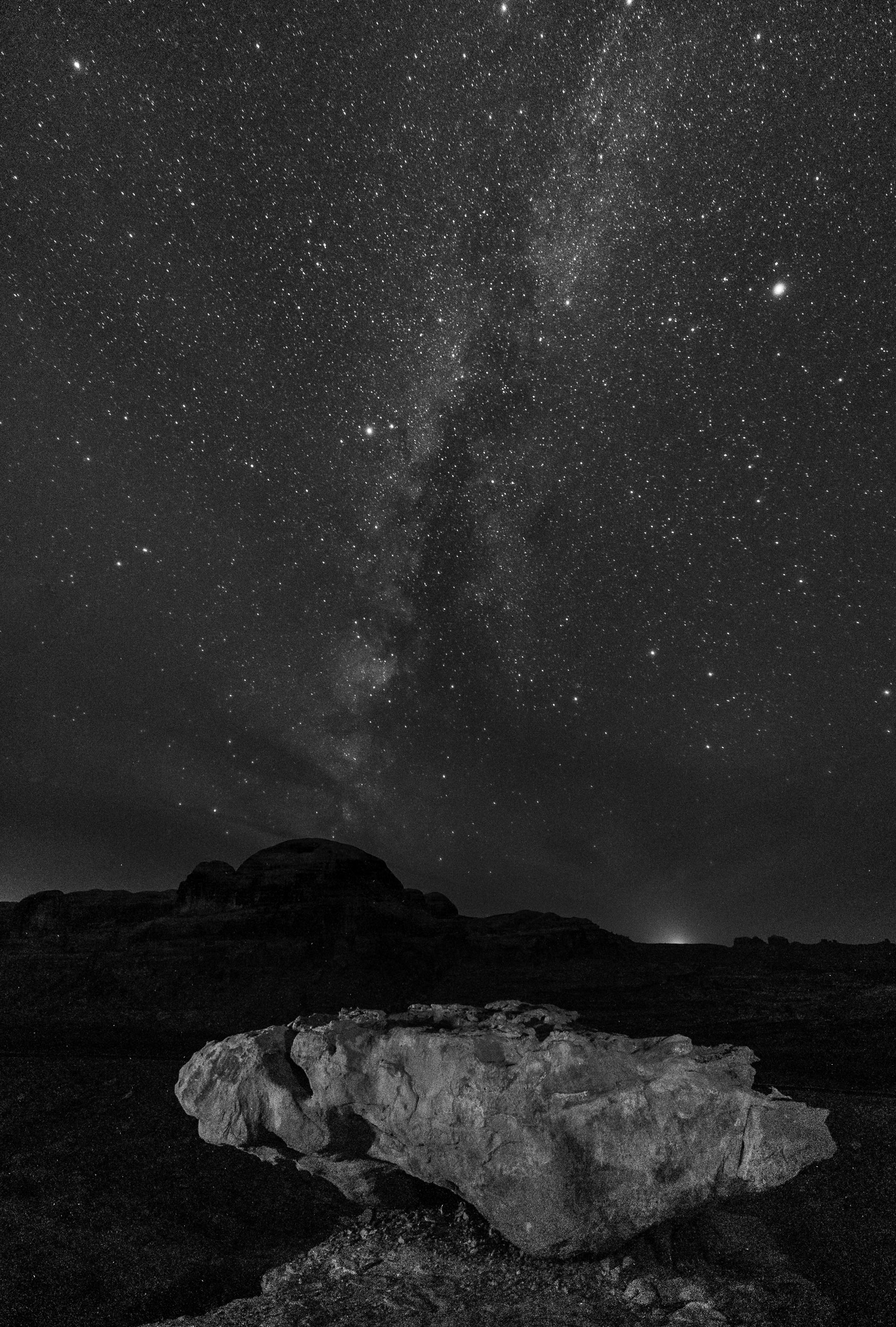 Milky Way and boulder, along the Corona Arch Trail, Moab, Utah. Nikon D3s,  Irix 15mm f/2.4 . 25 seconds, f/2.5, ISO 8000.