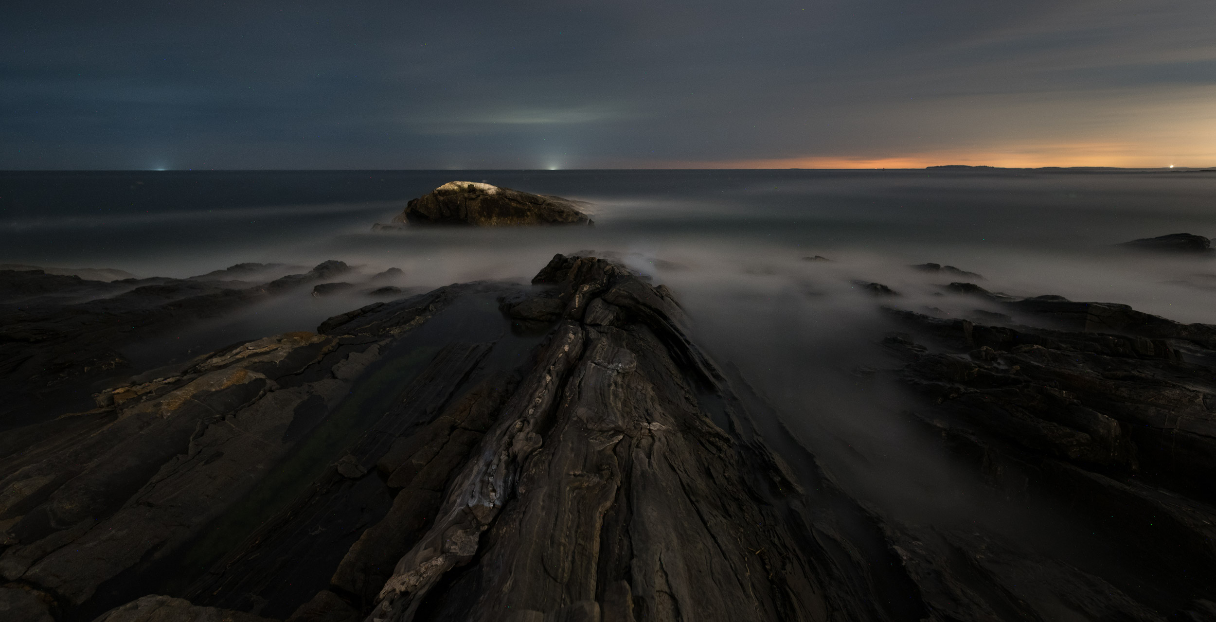 Pemaquid Point, Maine, sharp from front to back after focusing to a hyperfocal distance of 18 feet.  Nikon D750 , Sigma 24mm f/4 lens. 488 seconds, f/3.5, ISO 800.
