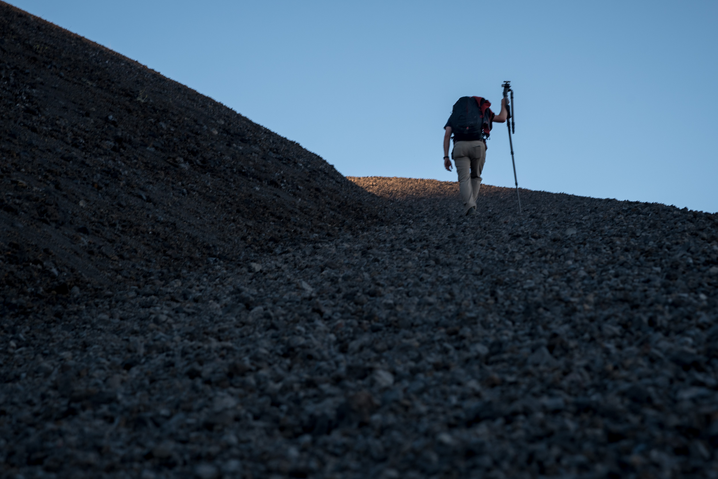 Type 2 Fun. Chris racing the sun to the top of Cinder Cone. Nikon D750,  24-120mm f/4  lens at 110mm. 1/60, f/7.1, ISO 100.