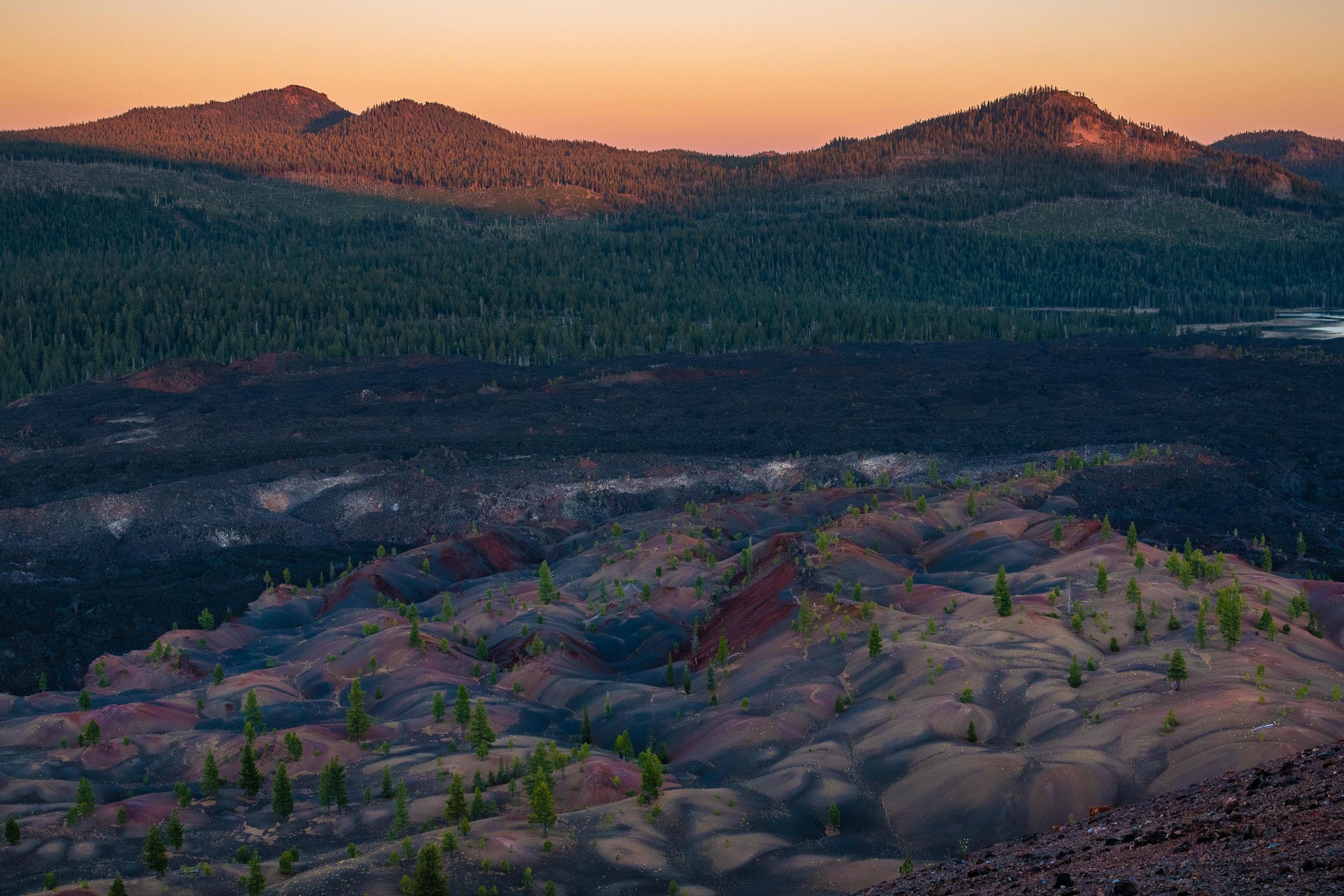 The Painted Dunes at sunset from Cinder Cone. Nikon D750, 24-120mm f/4 lens at 34mm. 1/25 second, f/8, ISO 400.