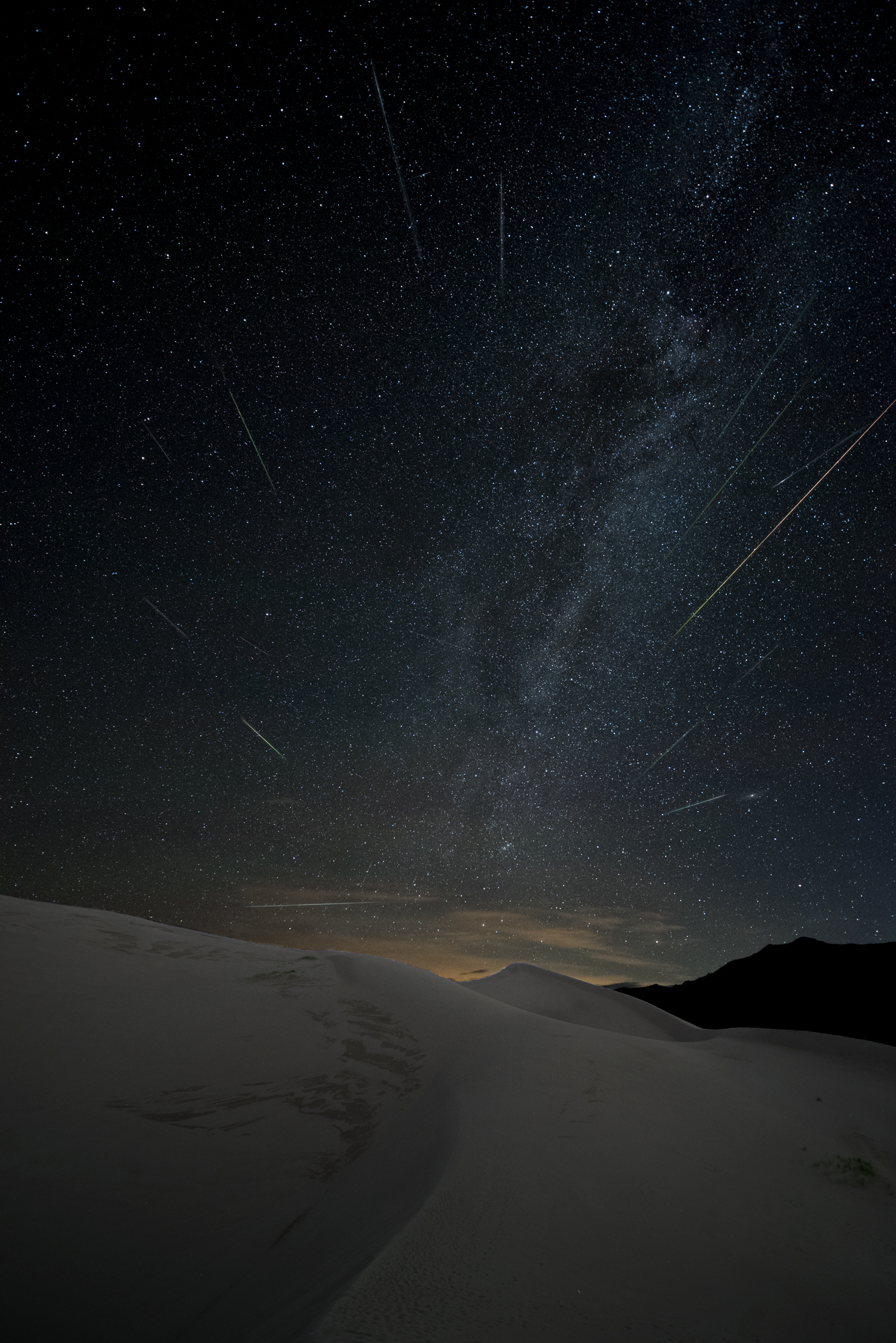 Great Sand Dunes National Park, Colorado. Nikon D750, 15mm Zeiss Distagon f/2.8 lens. 234 images at 22 seconds, f/2.8, ISO 6400, plus a single exposure at 382 seconds, ISO 2000 for the landscape after moonrise.