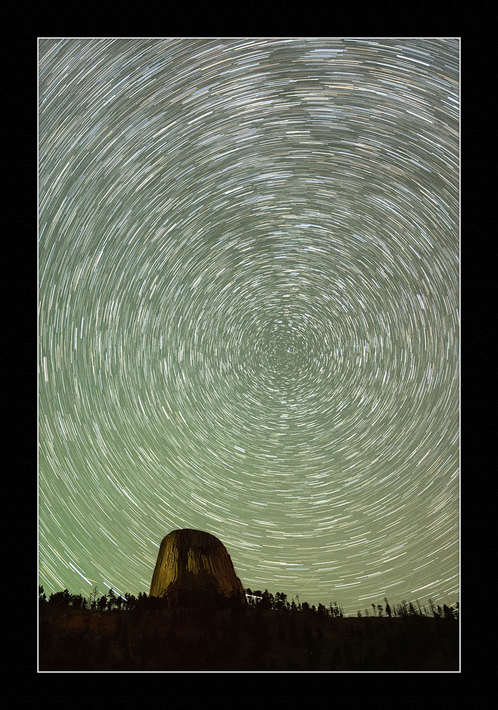 Stars at Devils Tower.  Nikon D750  with a  Zeiss 15mm Distagon f/2.8  lens. Ten stacked frames, each shot at 150 seconds, f/2.8, ISO 1600 (1,500 seconds total).