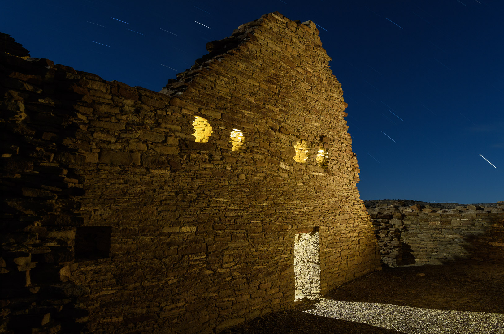 Chaco Canyon National Historical Park.  Nikon D5  with a  Nikon 24-70mm f/2.8  lens, light painted with a  Coast HP7R  flashlight and a  Luxli Viola  panel light. 10.5 minutes, f/11, ISO 100. © 2018 Chris Nicholson.