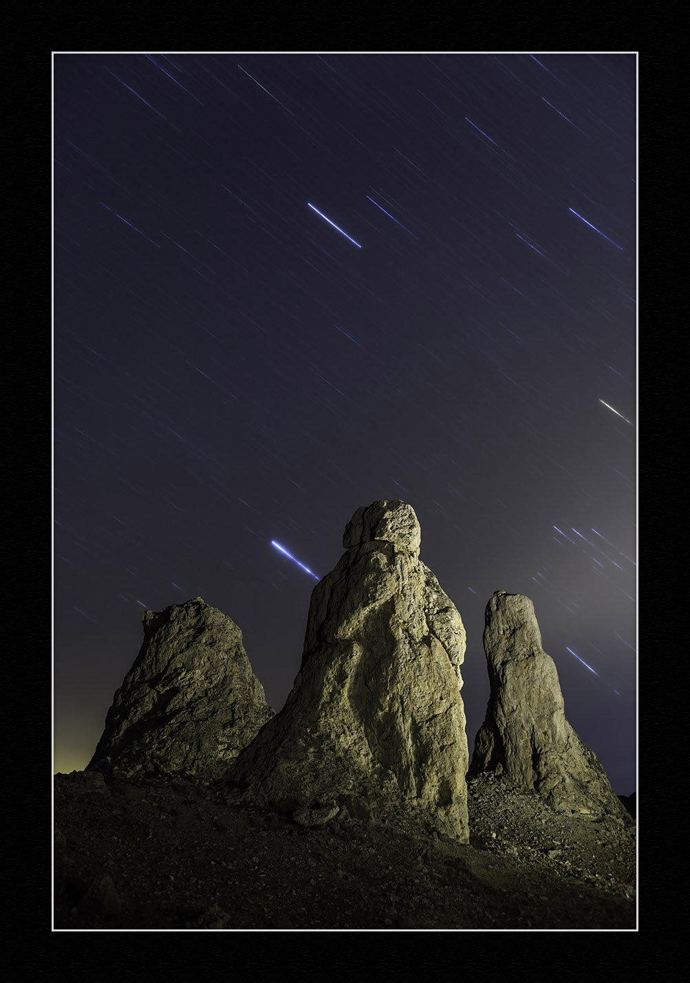 Star Trails and Tufa Spires,  Trona Pinnacles , California.  Nikon D5  with a  Nikon 24-70mm f/2.8  lens, light painted with a  Coast HP7R  flashlight with 1/2 CTO and -1/8 green gels. 20 minutes, f/2.8, ISO 100.
