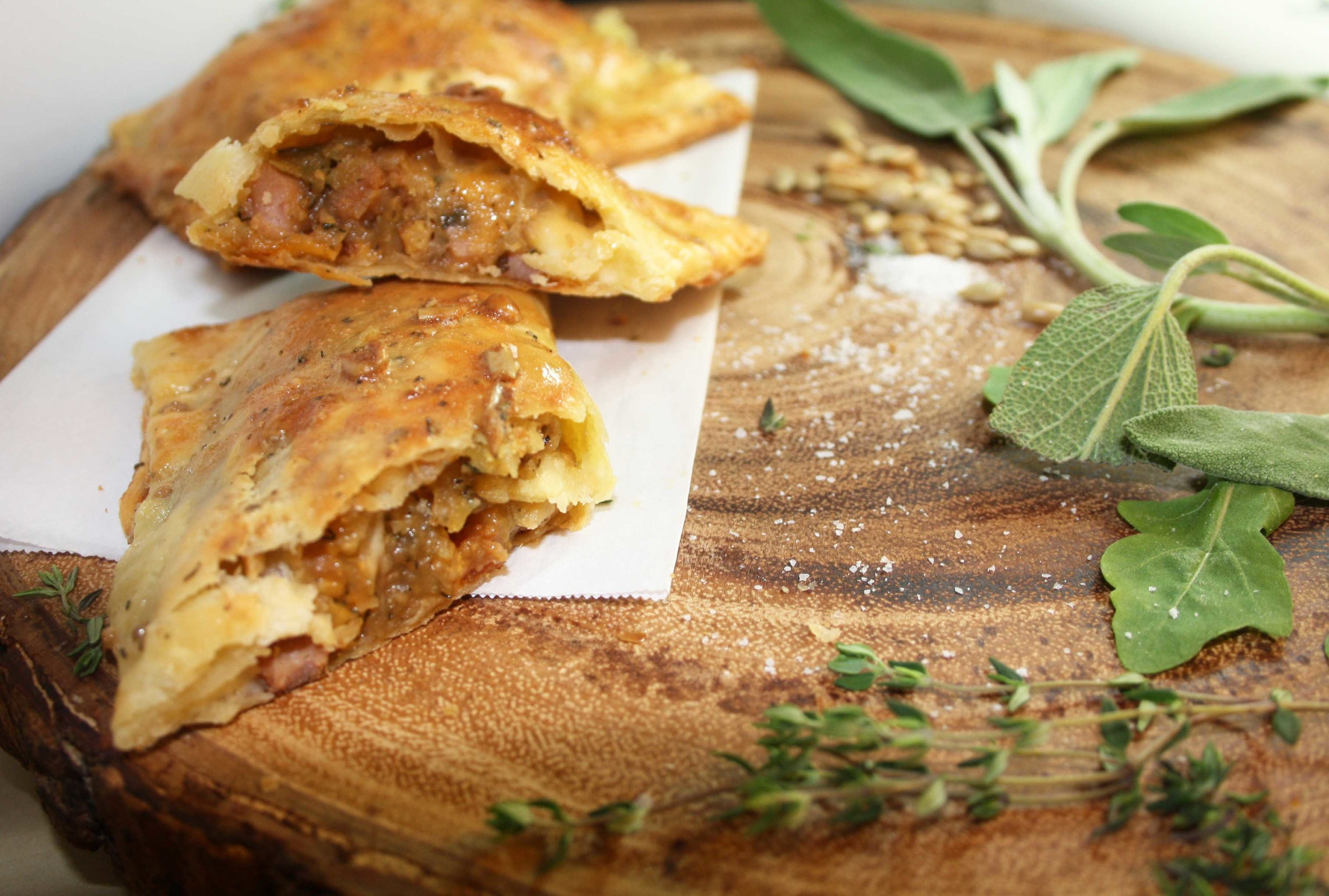 Canuck empanadas with peameal bacon, savoury potatoes and cheddar