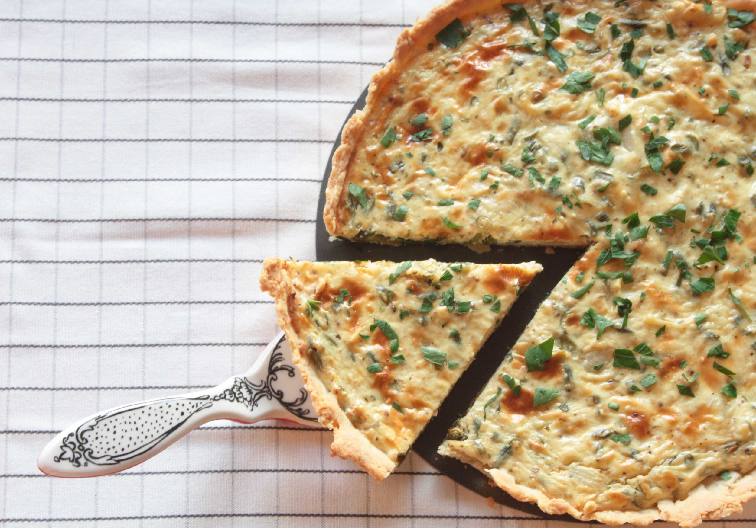 Garlic tart with scapes, green garlic and whole garlic