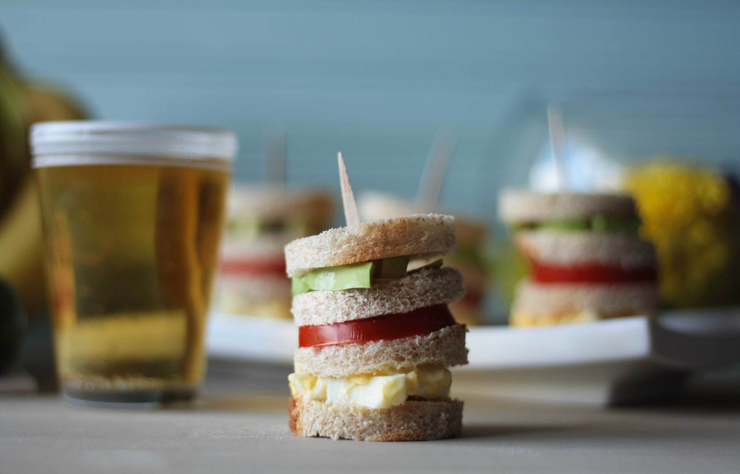 Triple Canapés - a traditional Perivian, triple decker sandwich with egg salad, tomatoes and avocado