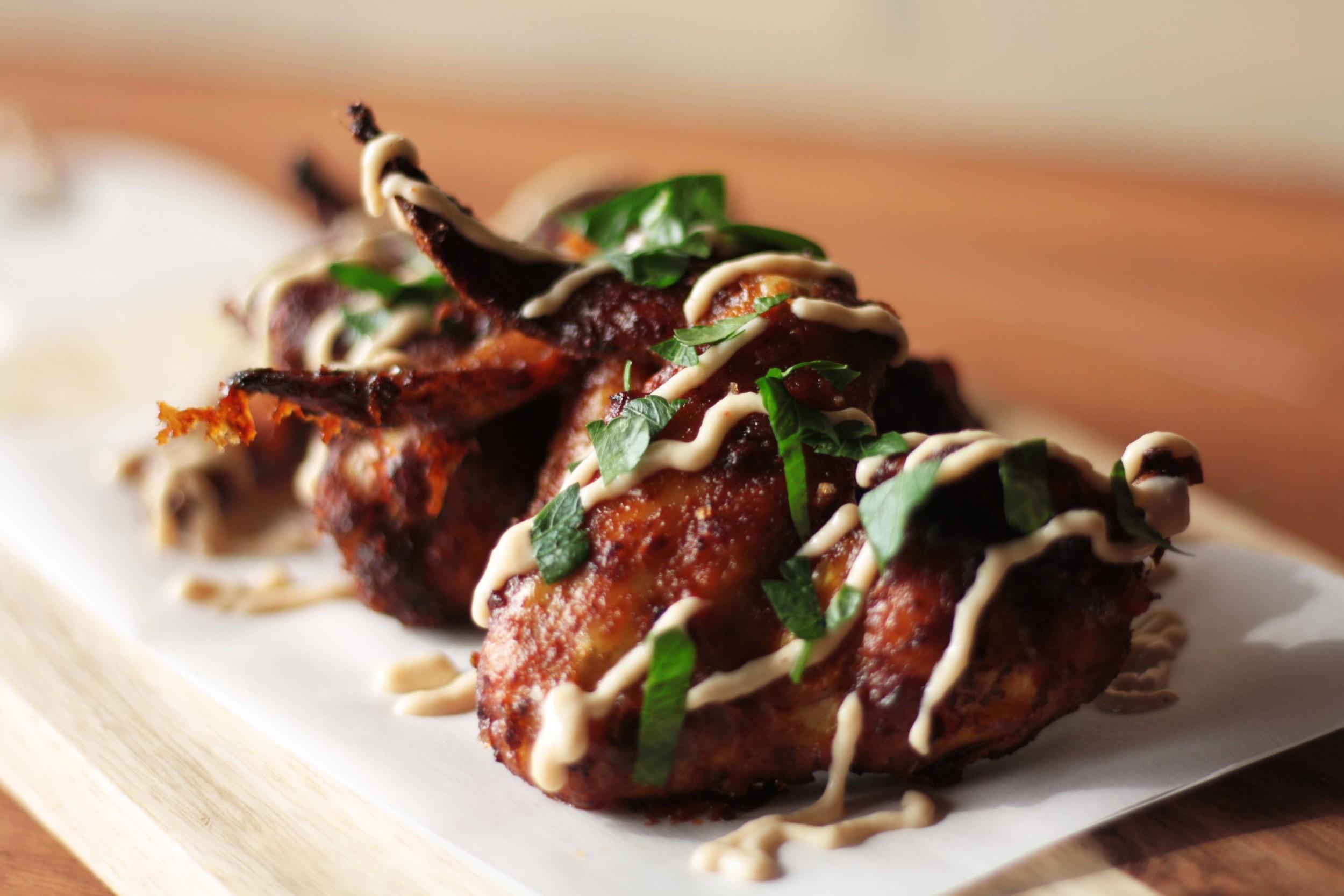 Sous vide shawarma chicken wings with roasted garlic tahini dip