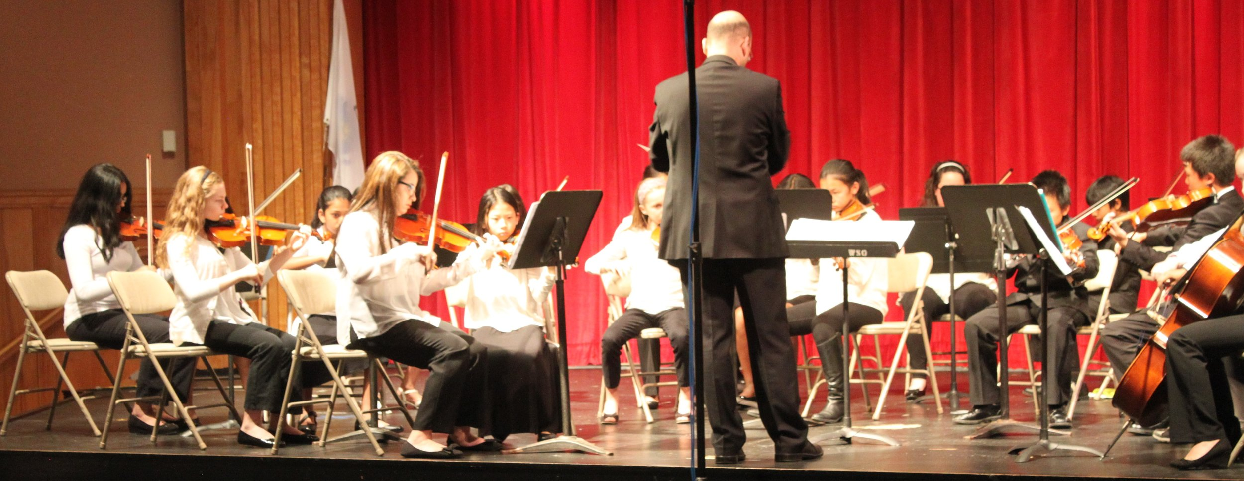 Dimitar Petkov leads members of the Claflin Hill Youth Repertory Ensemble