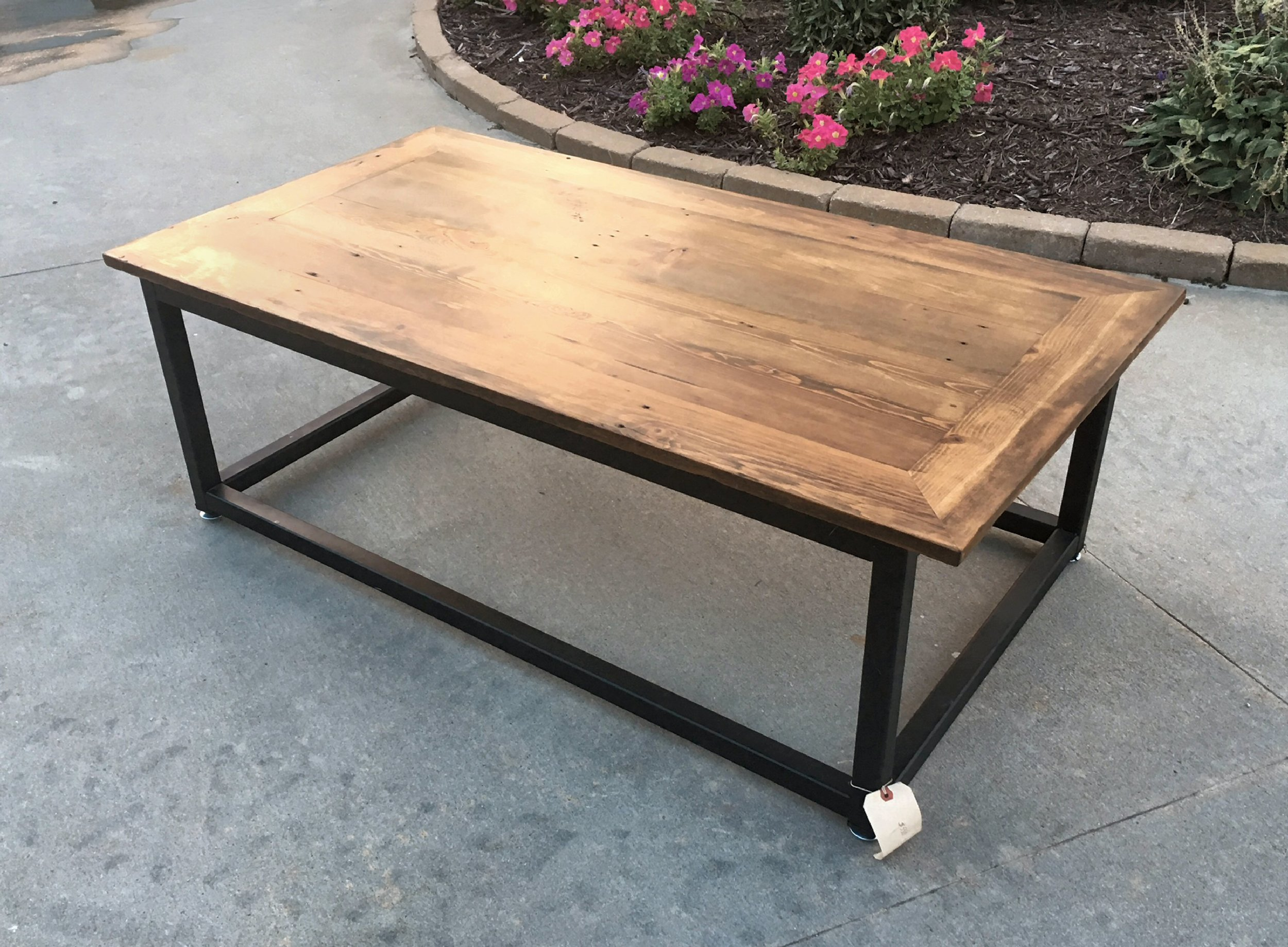 """Bring Rustic Charm to your home decor. The Brick Layers Coffee Table will add ruggedly sophisticated appeal to your living room furniture. The solid wood top has been cleaned and sealed, yet bears the nicks of time and the patina of use. The frame is a hand-welded 1 ½"""" steel base with a black satin finish. This coffee table blends reclaimed wood and iron into a timeless vintage modern piece. This coffee table is crafted of artfully distressed pine, so no two tables are ever exactly alike. Bring the lasting beauty of this bold living room accent to your home décor.    dimensions: 55"""" long x 29"""" wide x 17"""" tall...$550.00"""