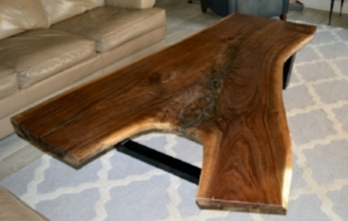 """This amazing and unique Black Walnut live edge coffee table is guaranteed to be the focal point of any living room. The wood slab is highly figured with long, beautiful feathering running along the center with a pyrite mineral inlay. This mineral's metallic luster and pale brass-yellow hue give it a superficial resemblance to gold, hence the well-known nickname of fool's gold.  The irregular walnut slab has raw edges and a fine polished surface, finished with natural oil. The base is made of 2"""" X 3"""" steel tubing, giving the table a modern industrial look.   Finished build measures: 71"""" L x 23"""" to 53"""" W x 16"""" H, and the slab is up to 3"""" thick. ABP Works designs furniture pieces integrating wood's organic characteristics with a clean, graceful, modernist aesthetic...$2300.00"""