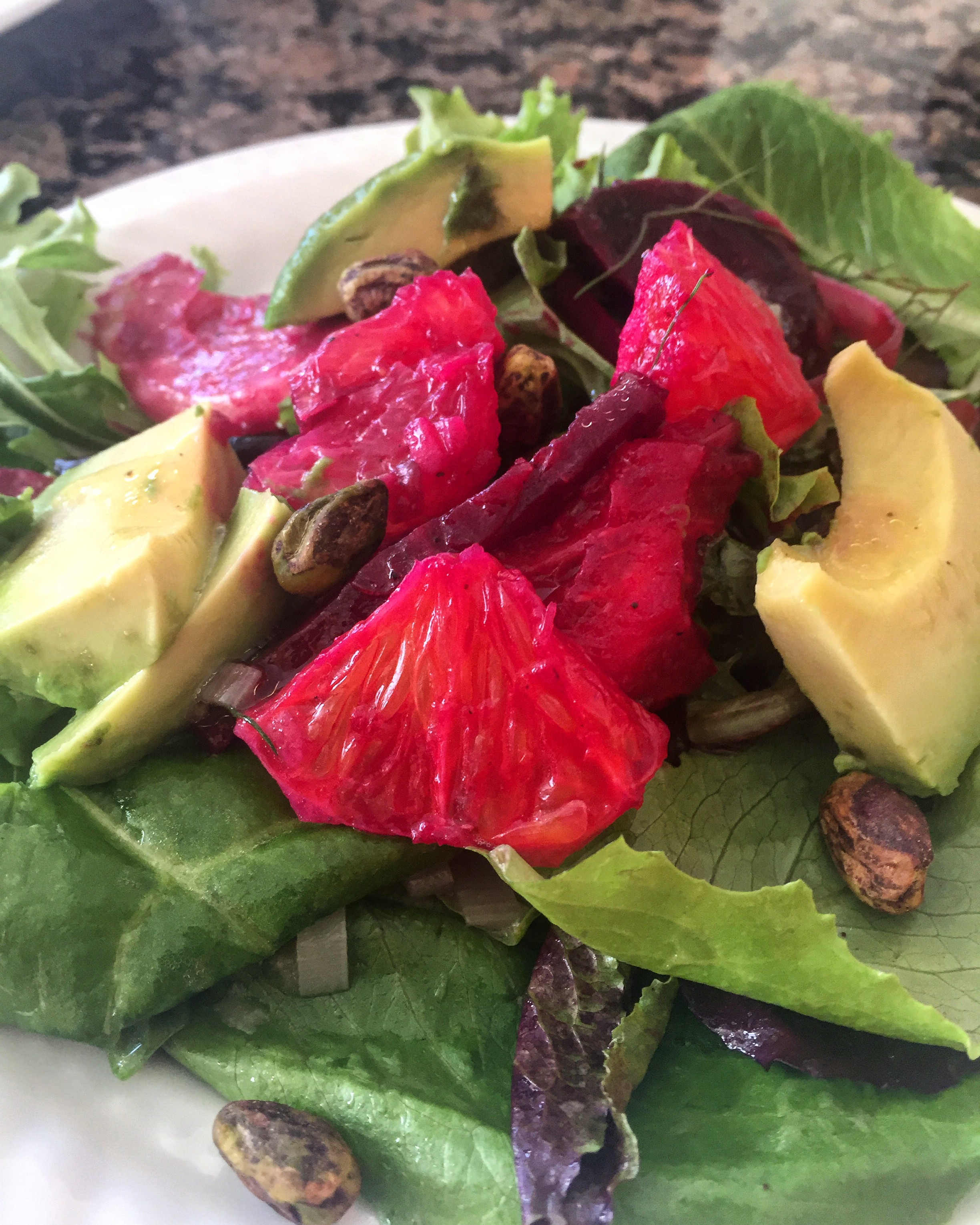 Roasted beet, orange and avocado salad with leek and meyer lemon confit.
