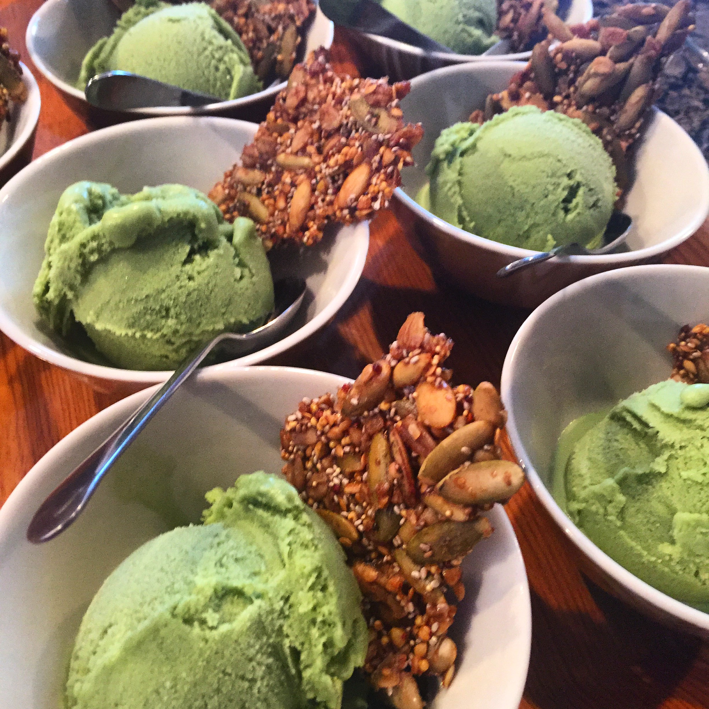 Matcha green tea coconut ice cream topped with maple quinoa brittle