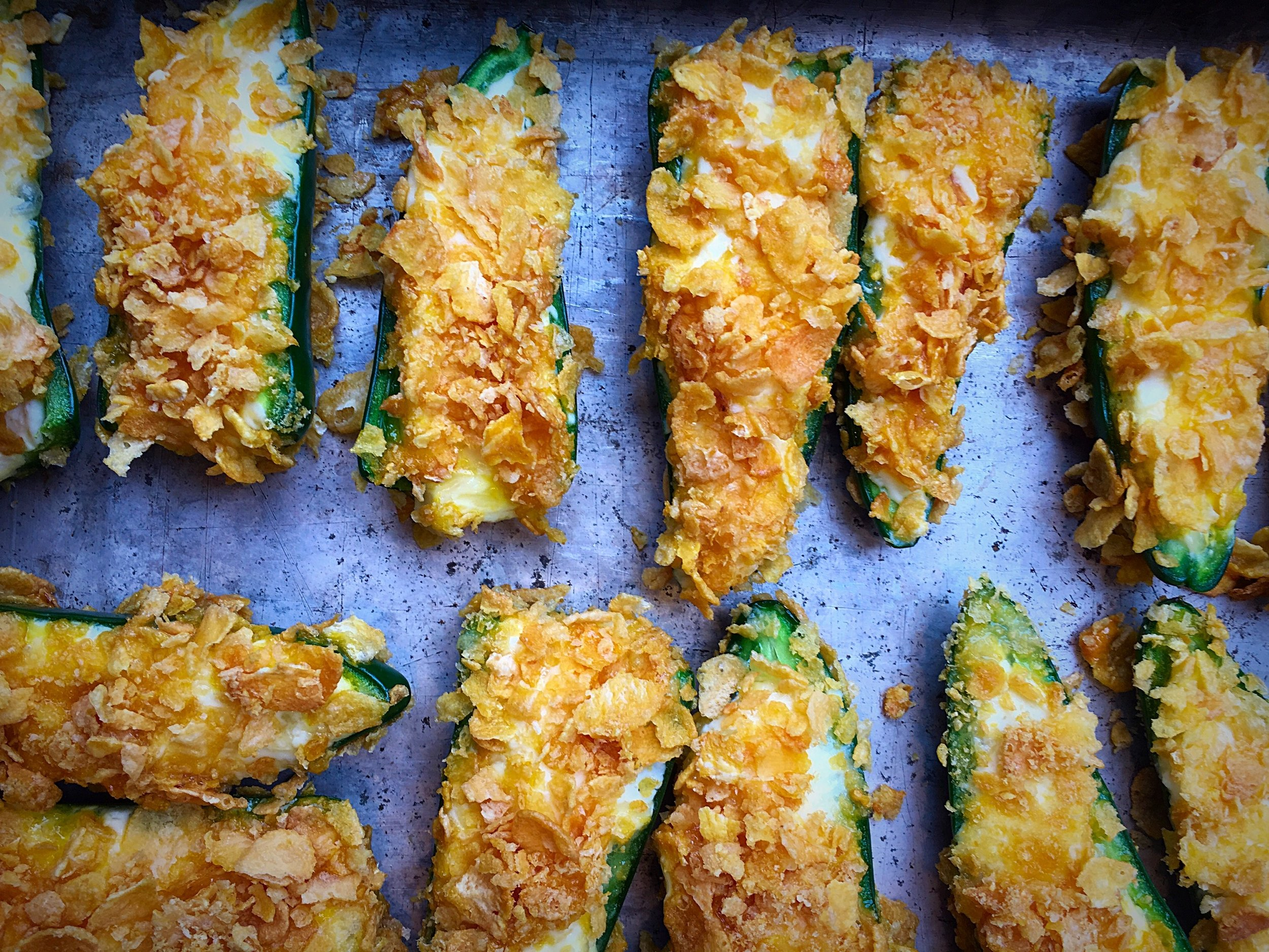 What You'll Need:  1 dozen fresh jalapenos, sliced lengthwise and seeded*  1 package organic cream cheese, or Neufchatel**  1/2 c shredded cheddar, or other hard cheese  2 eggs, whisked  2 c organic corn flakes, crumbled