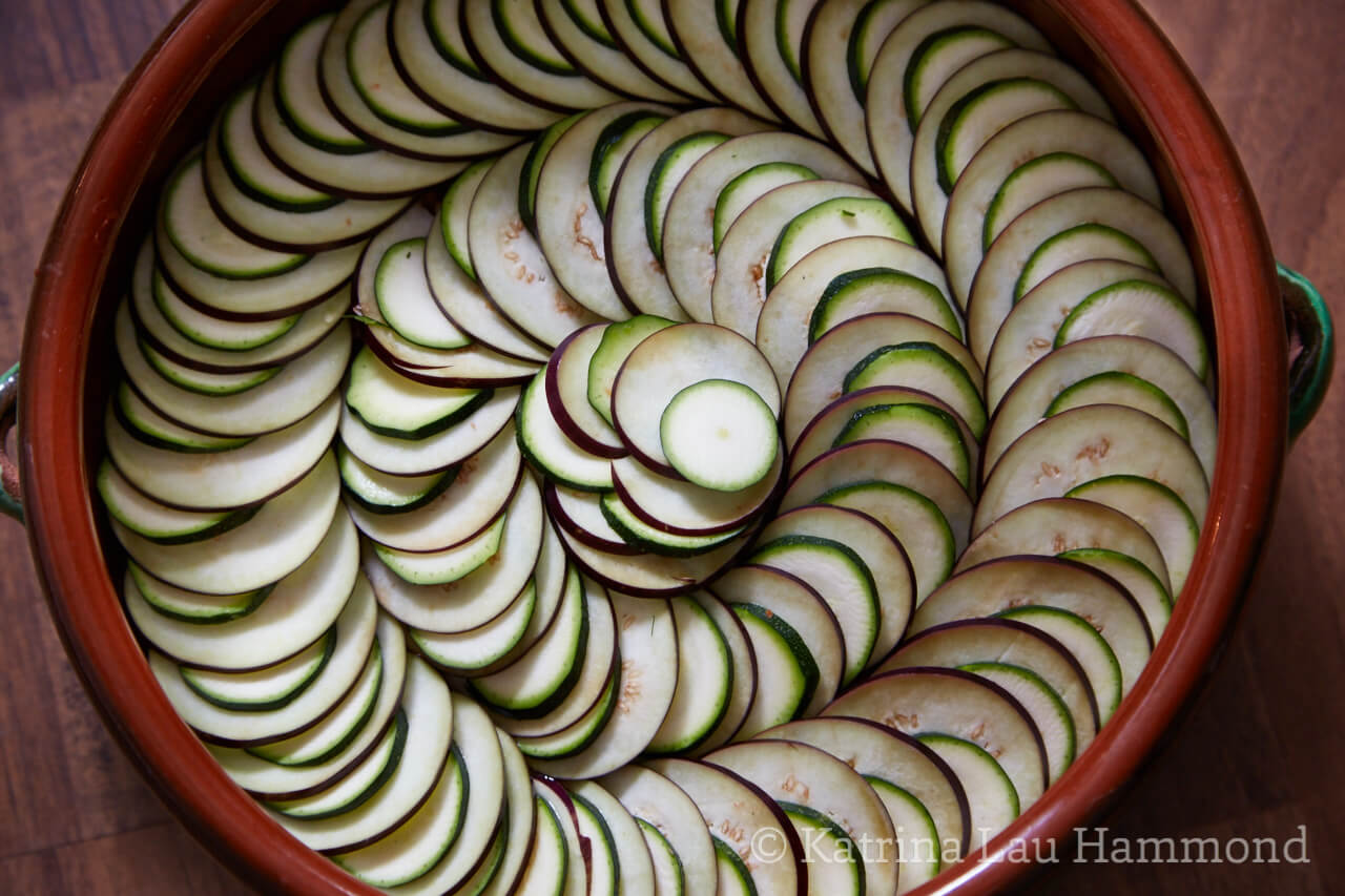 Concentric circles of overlapping slices of courgette (zucchini) and aubergine (eggplant)