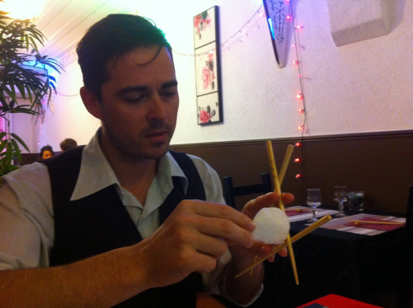 Gregory demonstrating the movement of phages through mucus, with the assistance of three chopsticks and a prawn cracker, over dinner at Fuji Yama