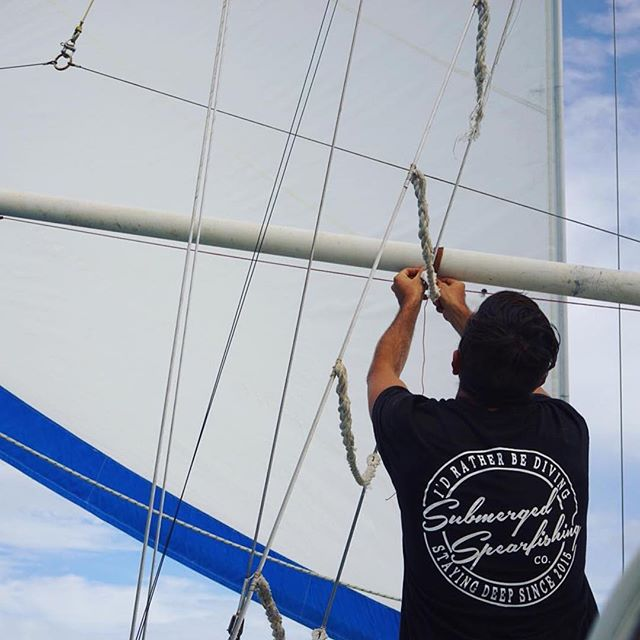 @sailing_nandji ・・・ On passage, Yosh fixing a strip of leather to the pole to prevent chafing on the shroud. ⛵️🌏💦