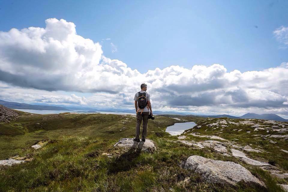 Climbing Dun Caan. Loch Meilich to the right. Photo by Katherine Williams Photography.