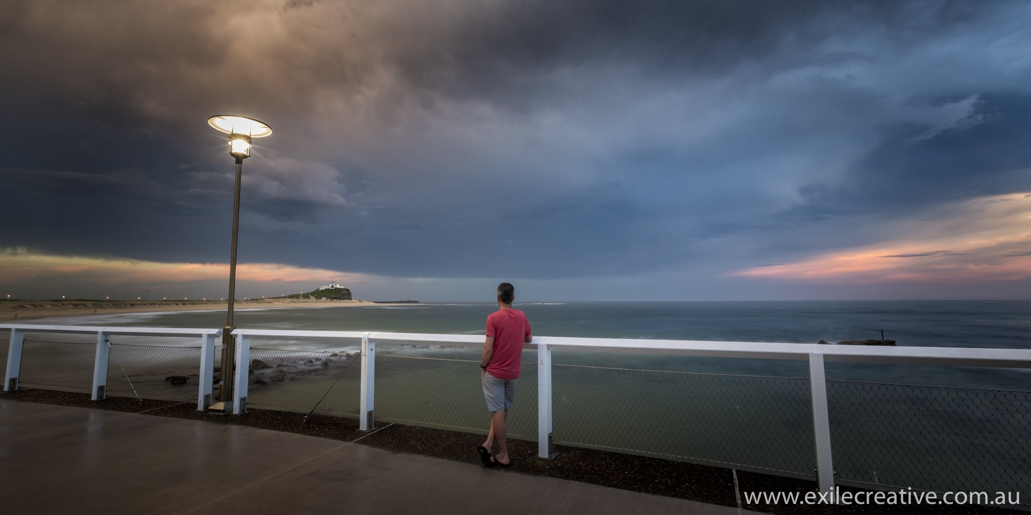 Watching the storm roll in over Nobbys