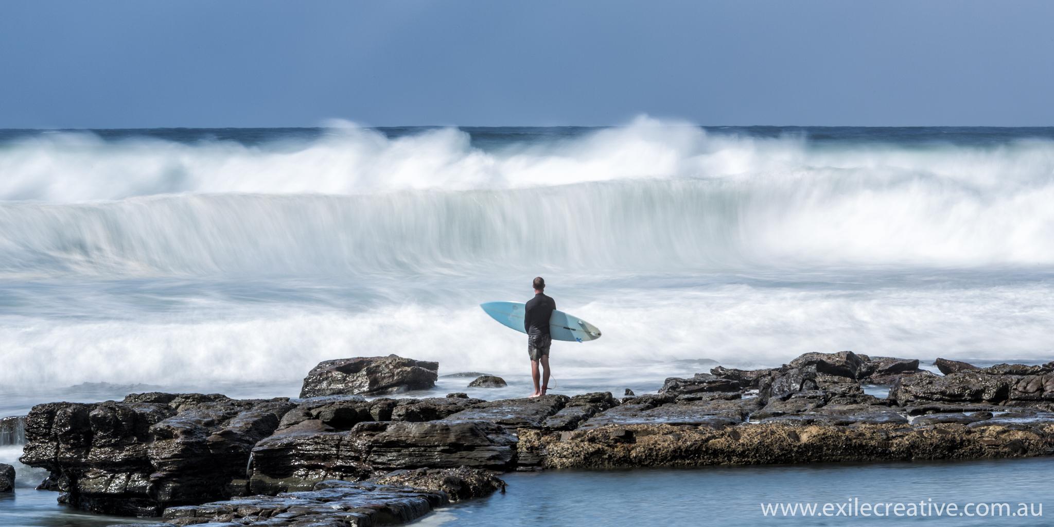 A surfer waits
