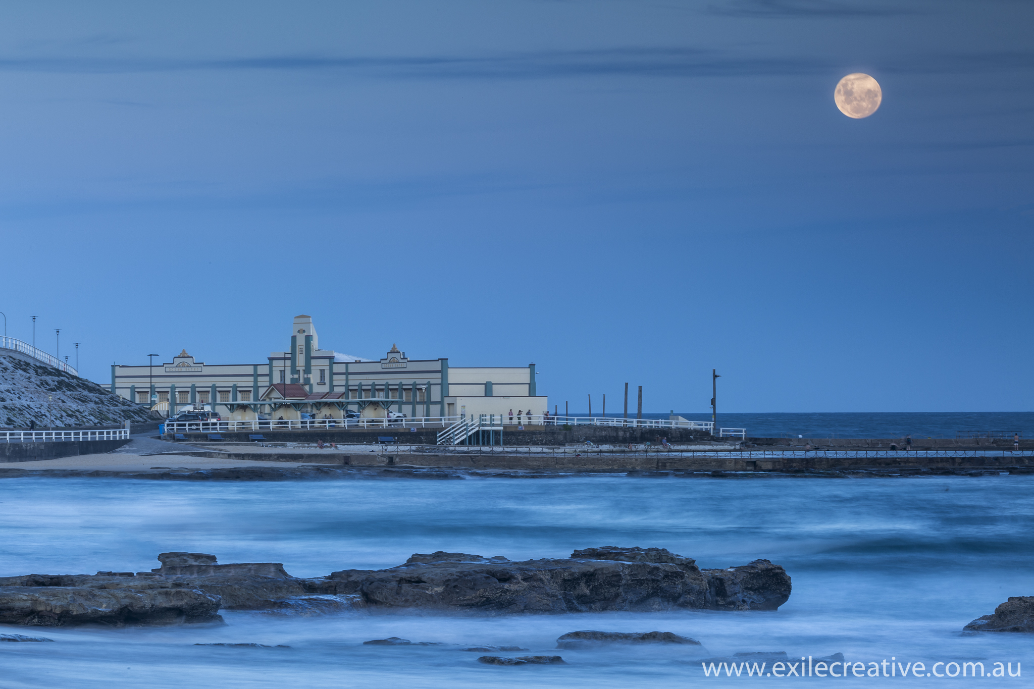 The moon rising over the Newcastle Baths