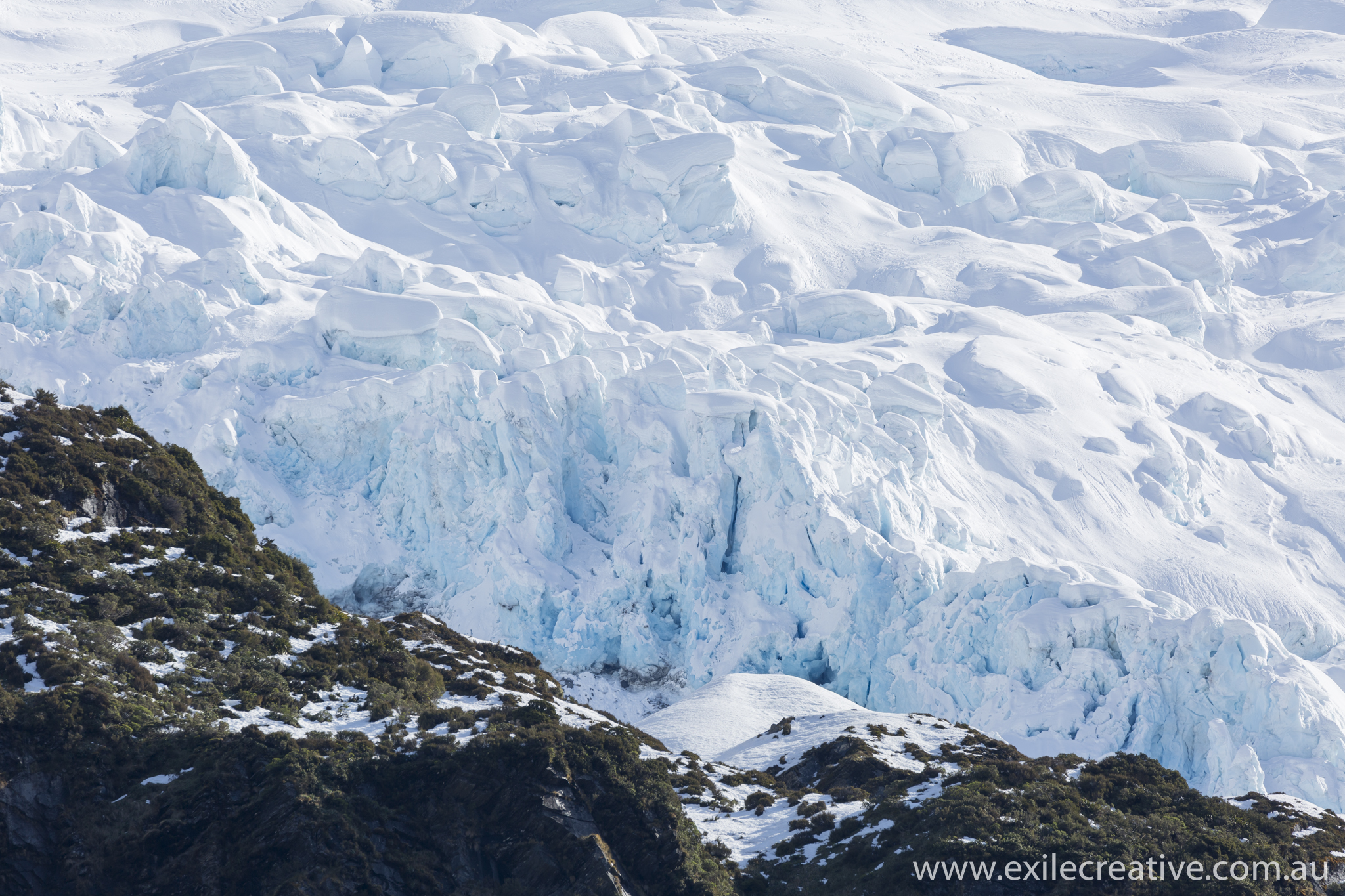 The front end of Rob Roy Glacier breaking over the cliff.  Canon 5Dmiii, 100-400L ii IS @ 400mm, ISO100, f/8, 1/500s
