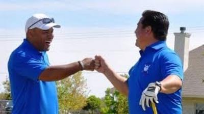 golf coach fist bump.jpeg