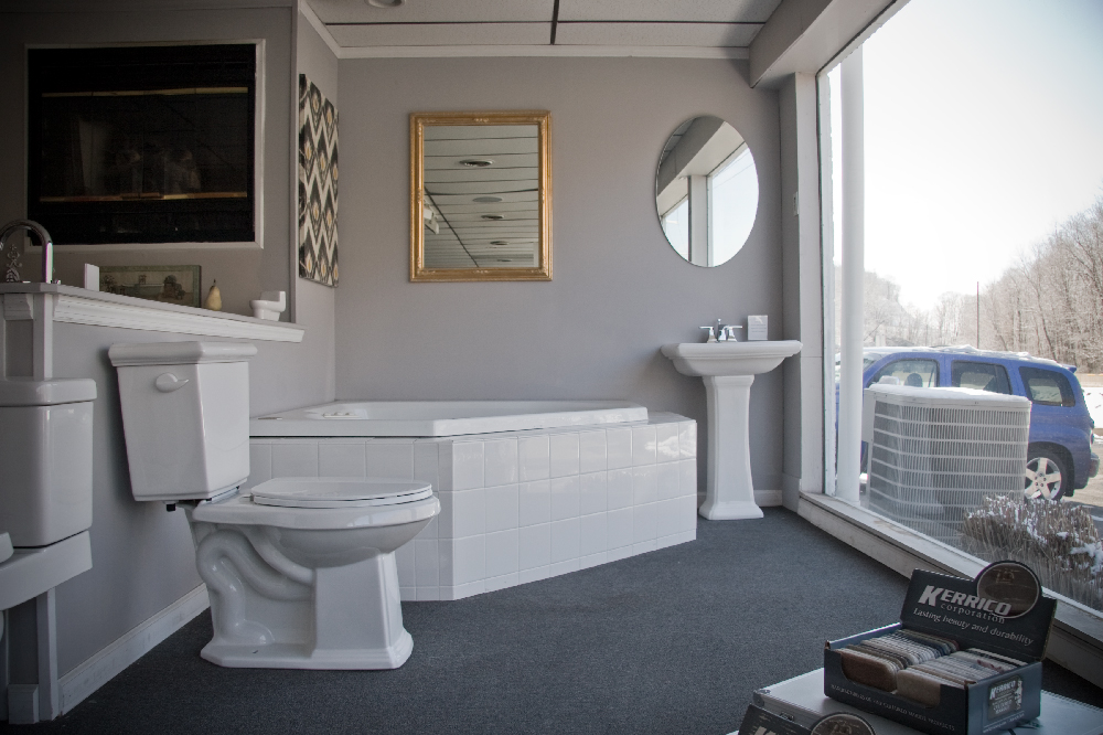 Toilet, spa bathtub and pedestal sink.