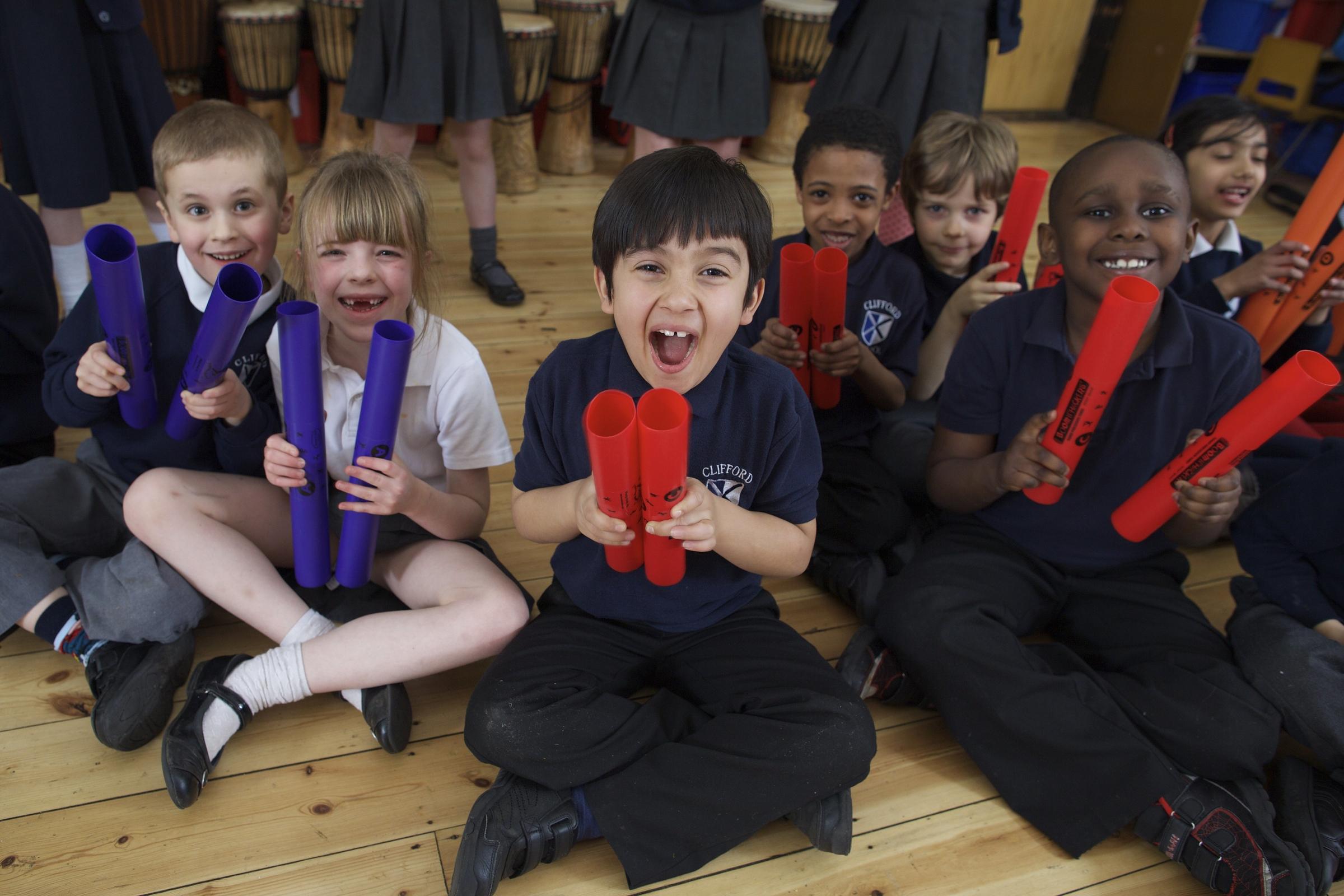 Kids having fun at Unbeatable Energy drumming workshops.