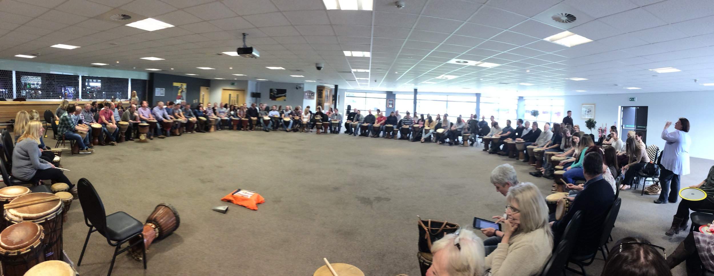 Unbeatable Energy leading a large drumming workshop for Charter Housing Association in Newport, Wales